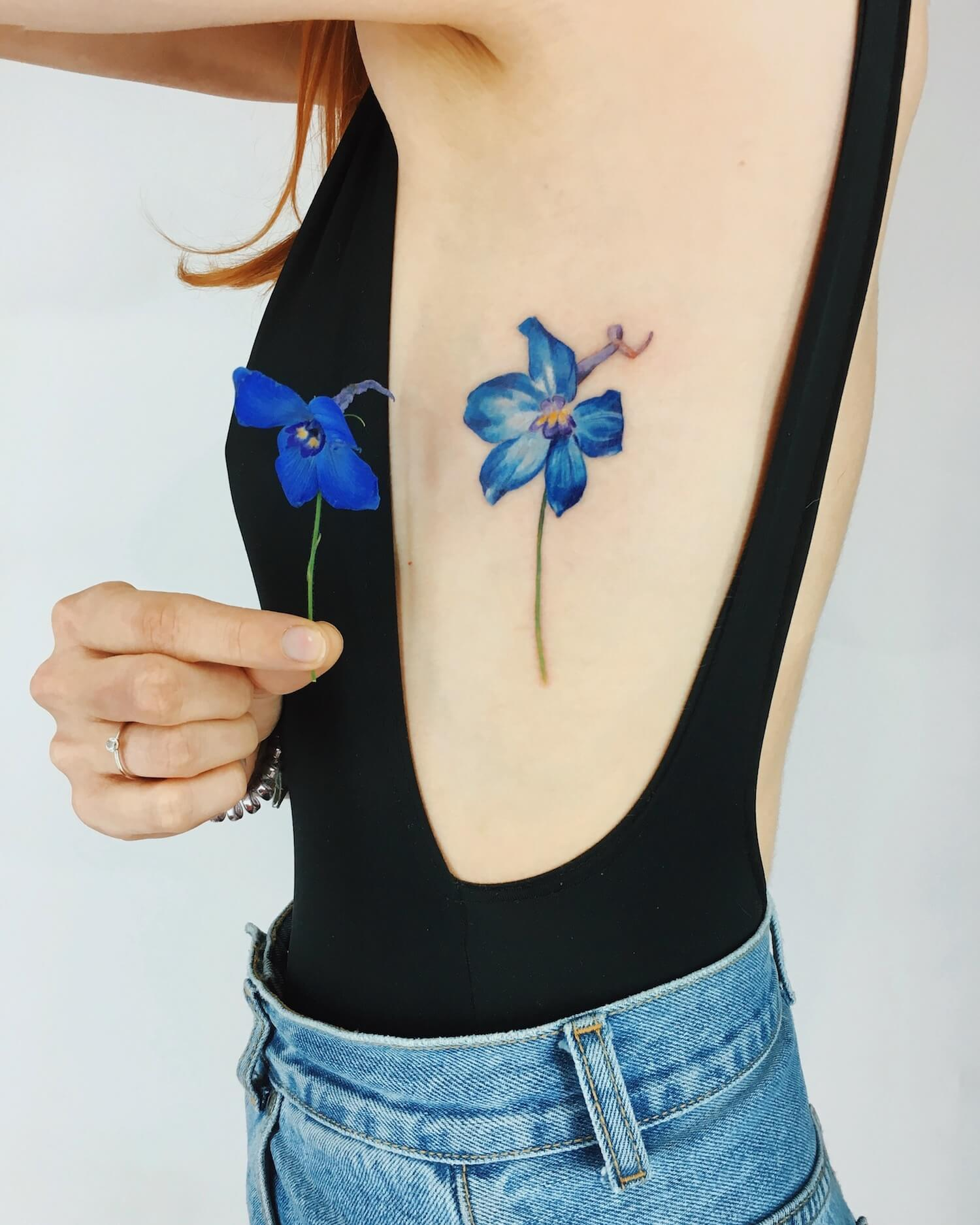 Flower tattoo on arm by Rit Kit