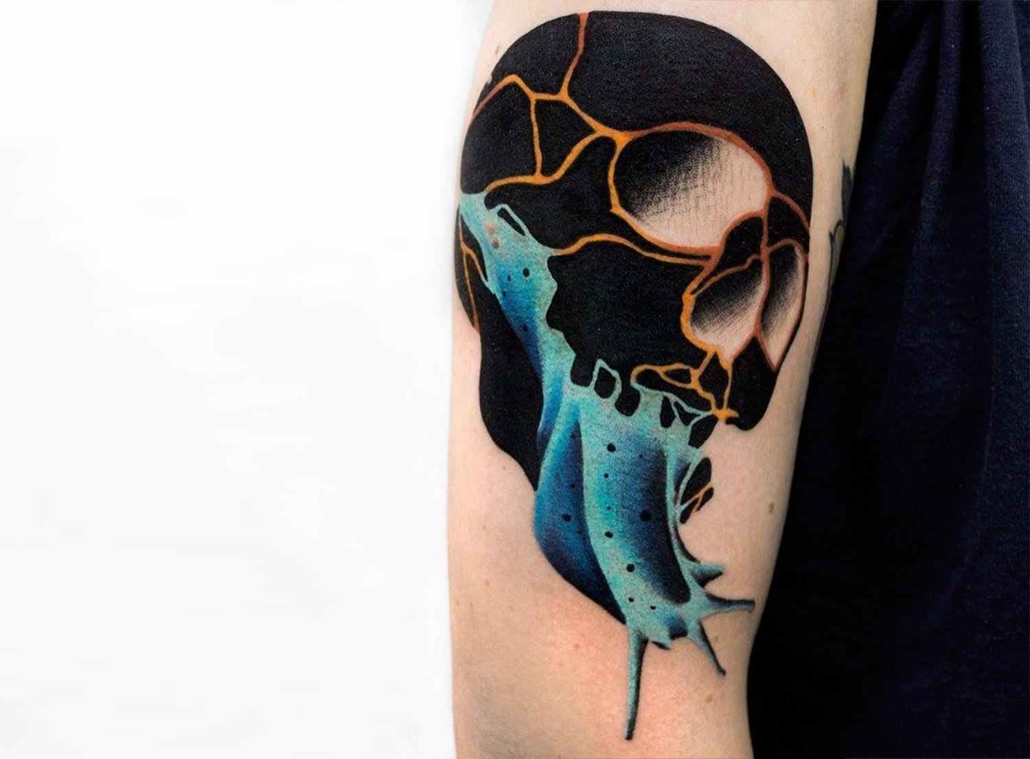 innovative skull, black ink and color, tattoo on arm