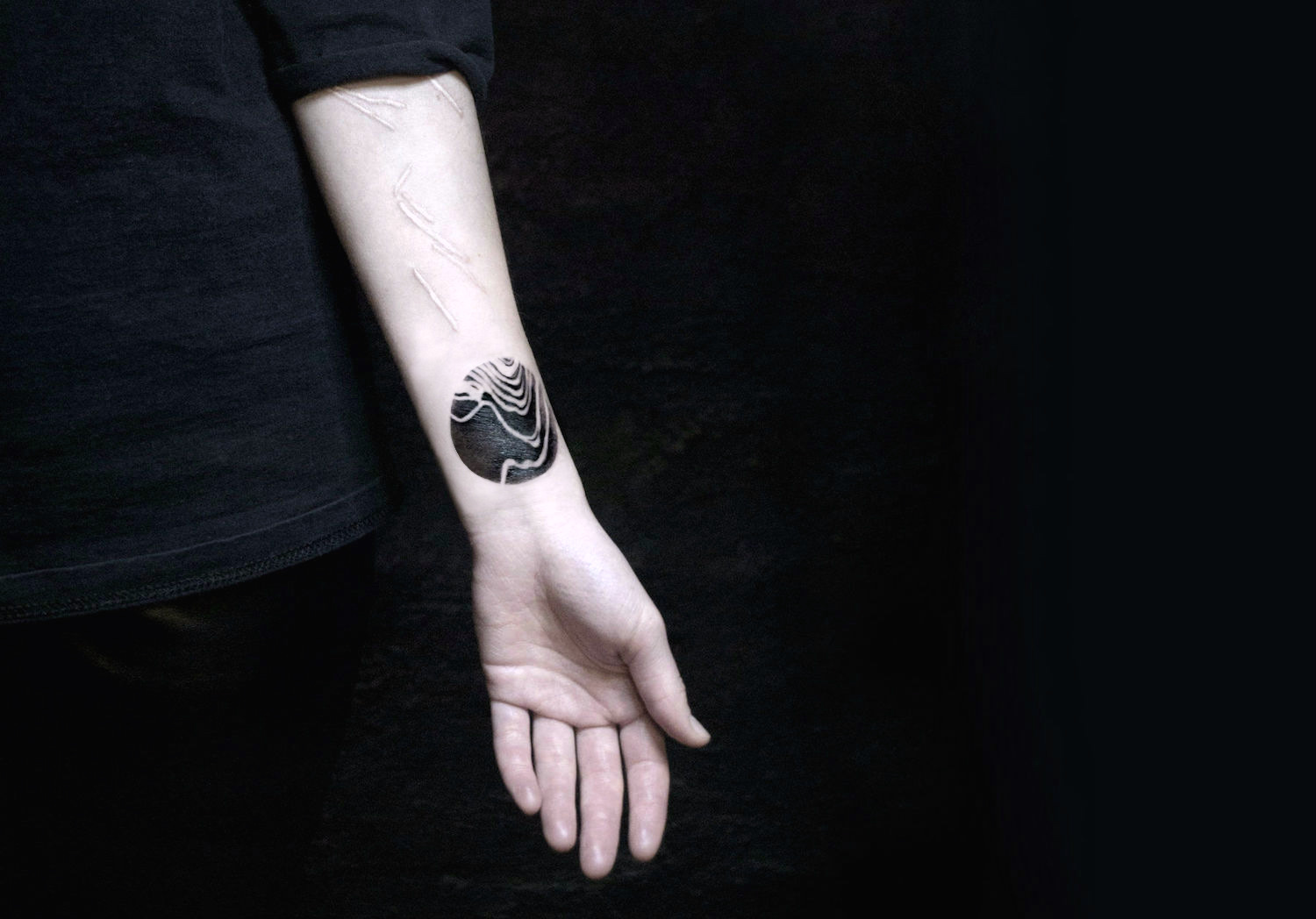 White and black ink tattoos by Nastasja Barashkova