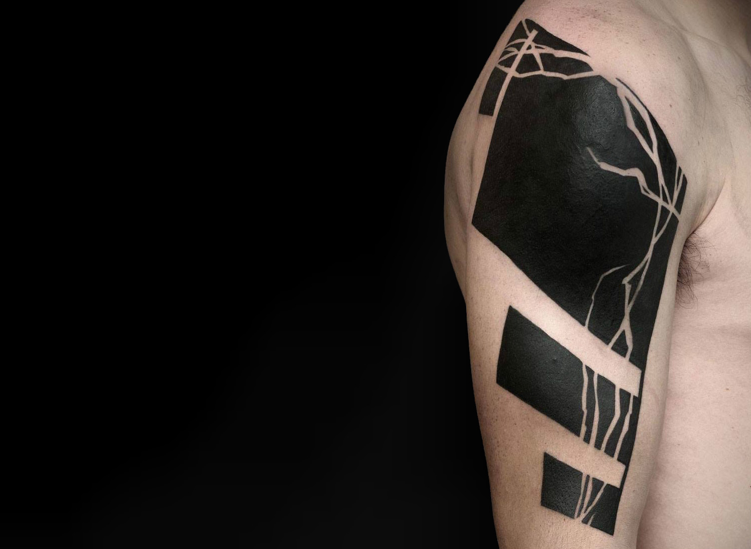 Heavy blackwork tattoo by Olivier Poinsignon