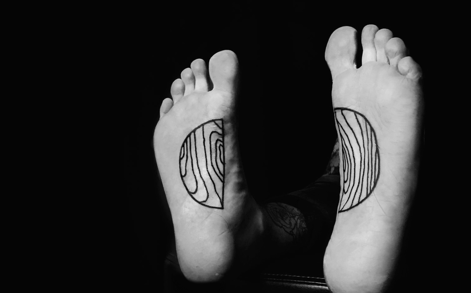 Wood grain foot tattoos by Warren Moris