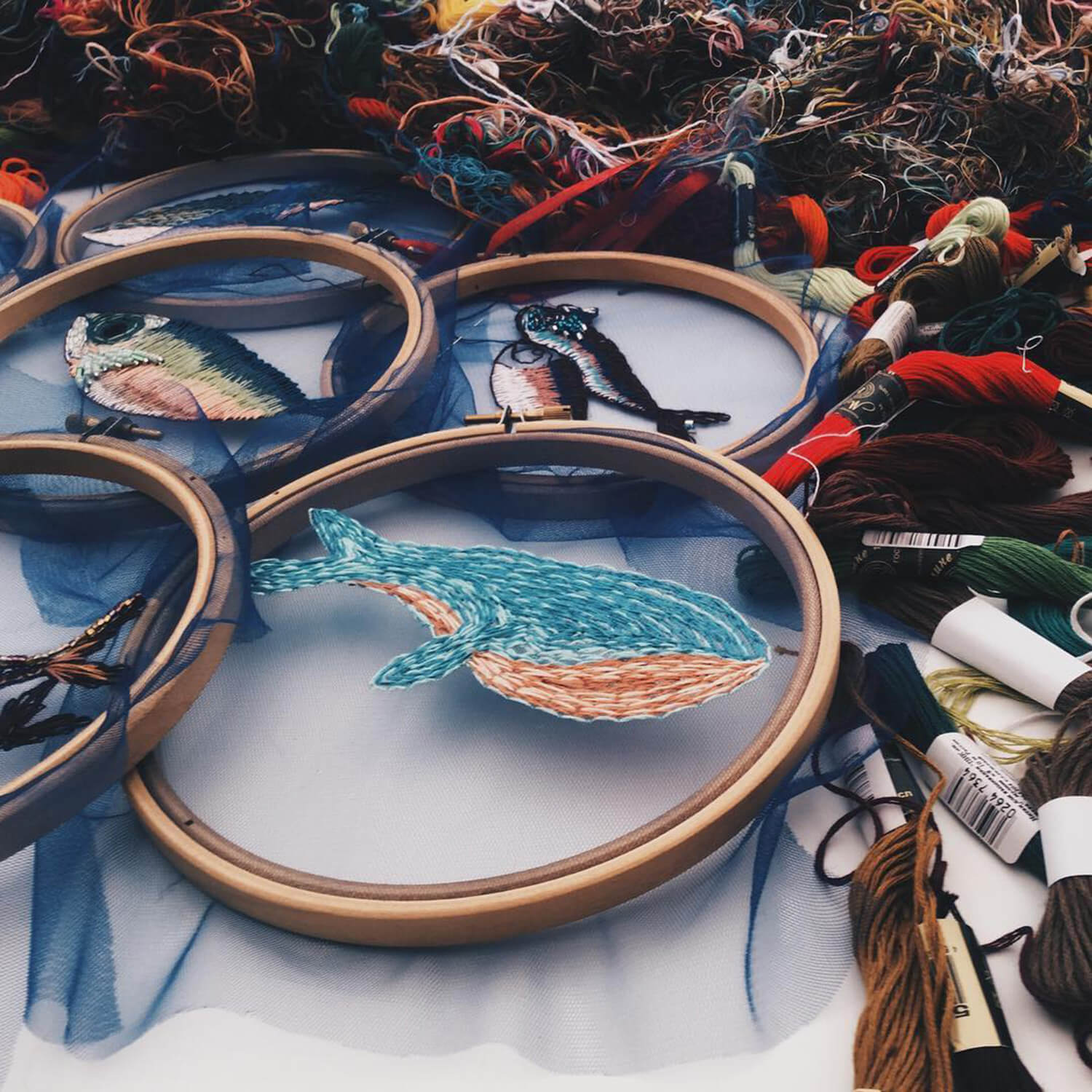 Embroidery of a whale in an embroidery hoop