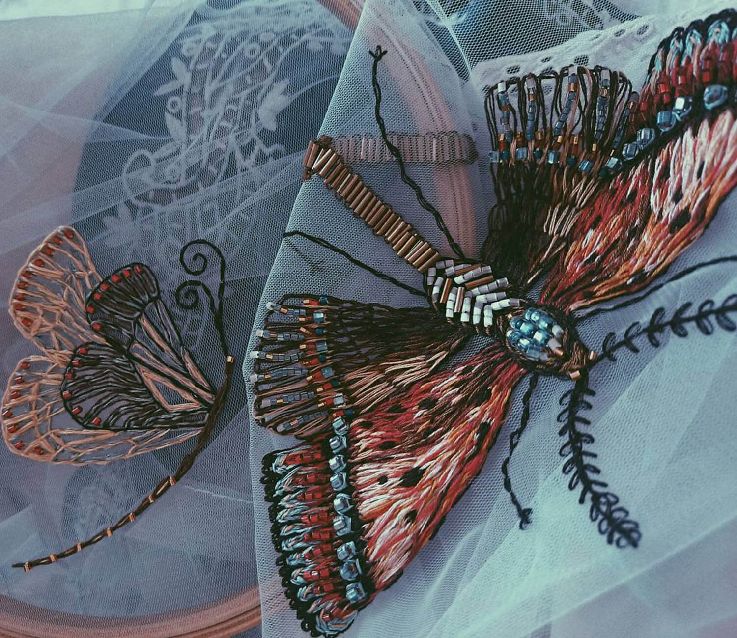 Butterfly embroidery with beads stitched on tulle