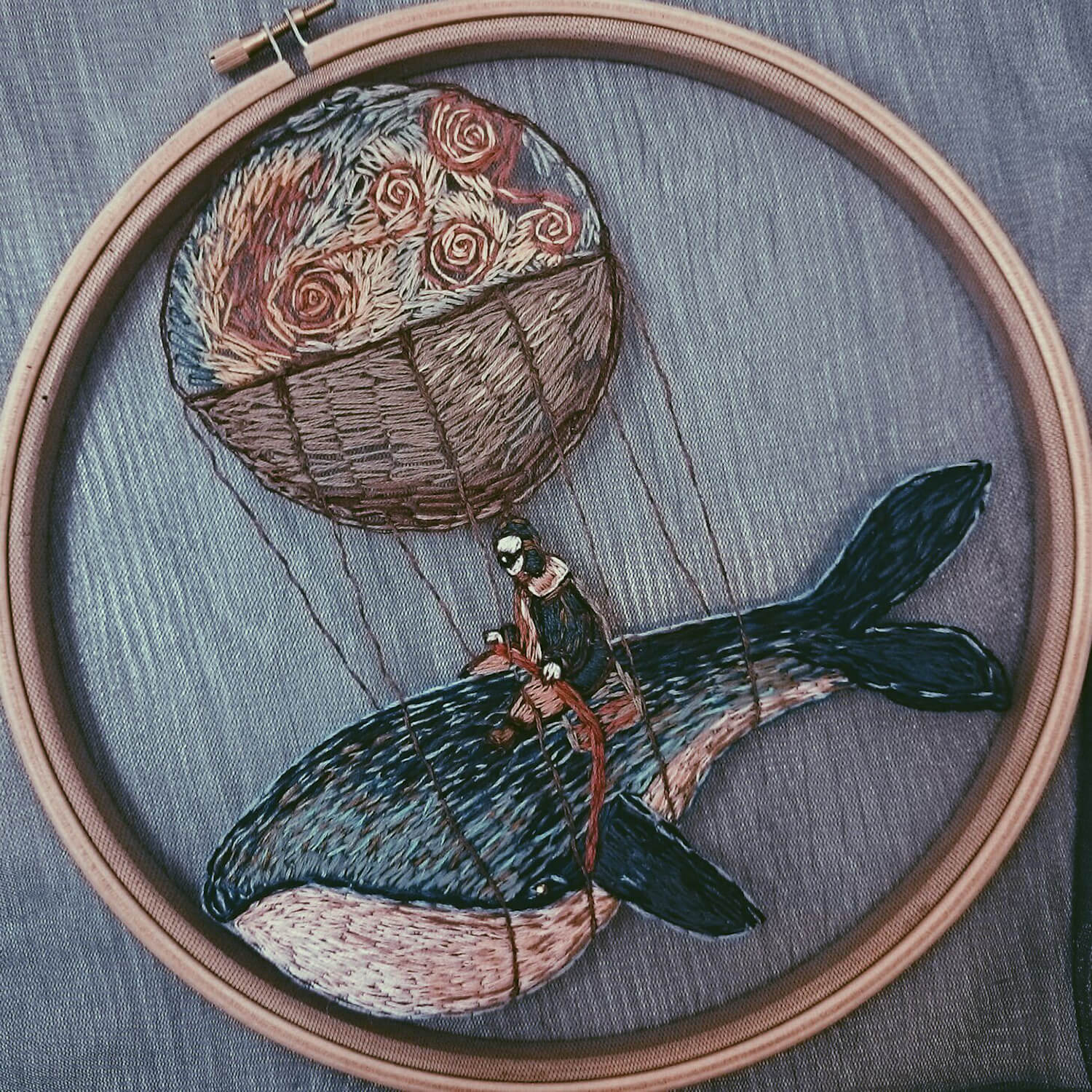 Fantastical flying whale embroidery