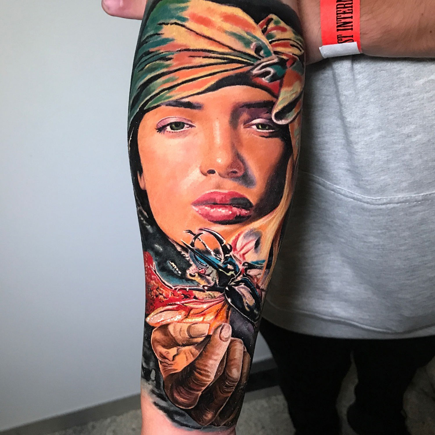 colorful portrait, realistic tattoo on arm, tattoo convention