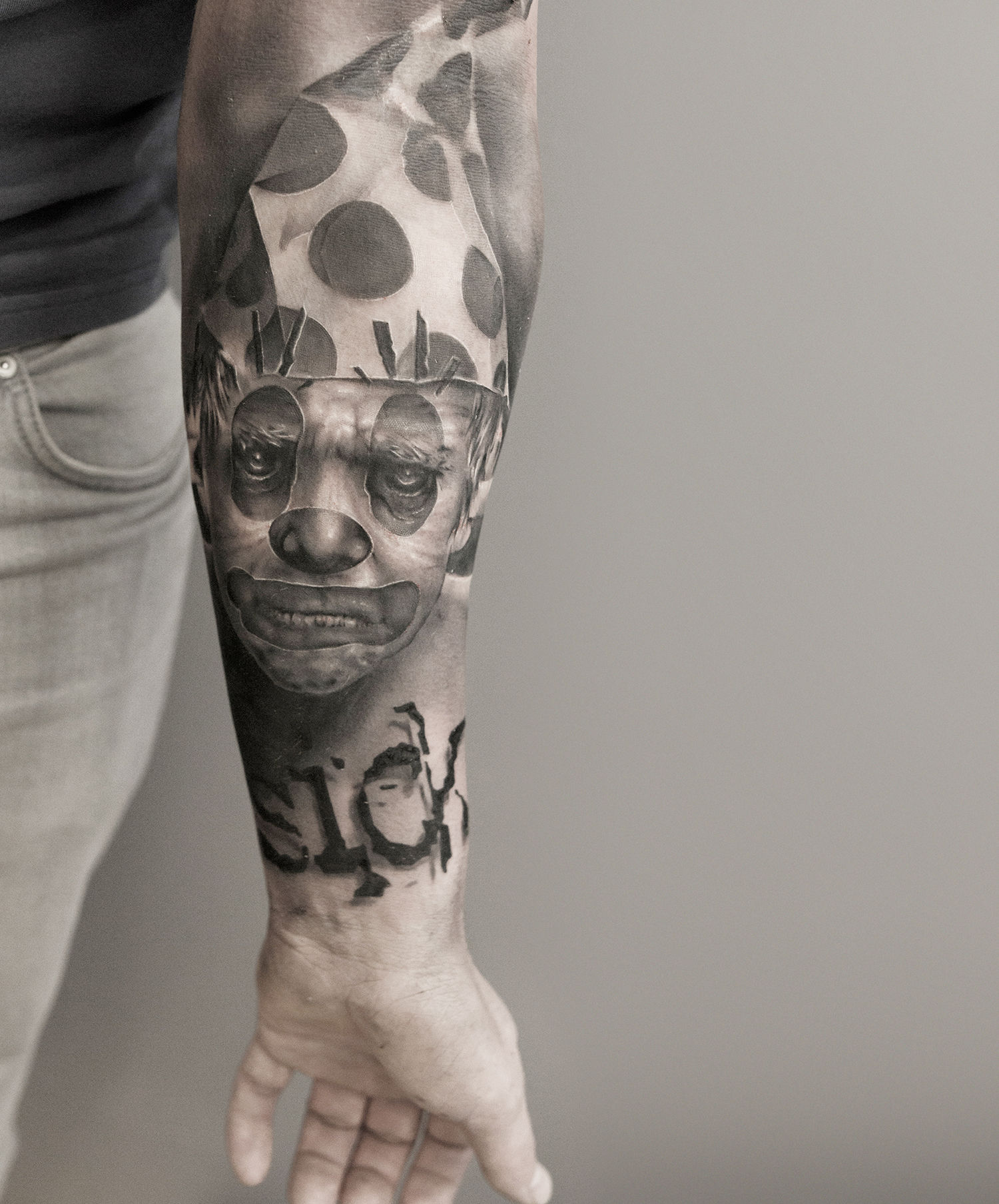 pope clown tattoo on arm