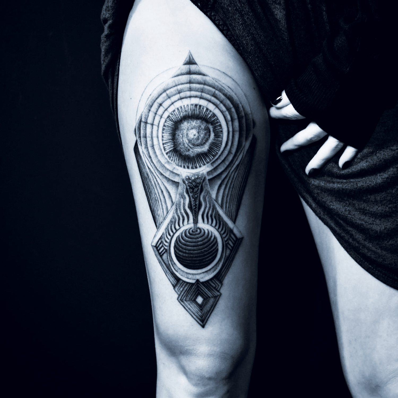 Placide Avantia - leg tattoo