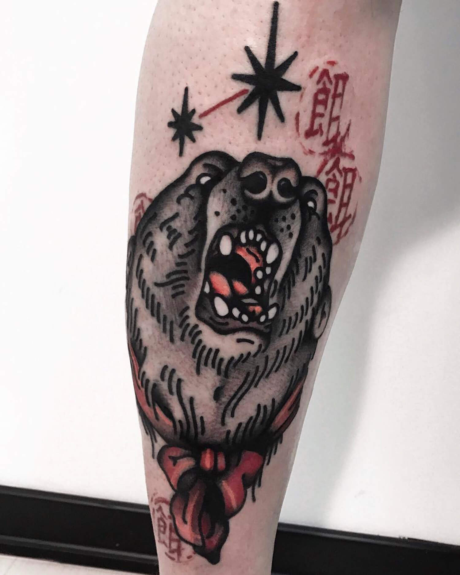 Bear tattoo on leg