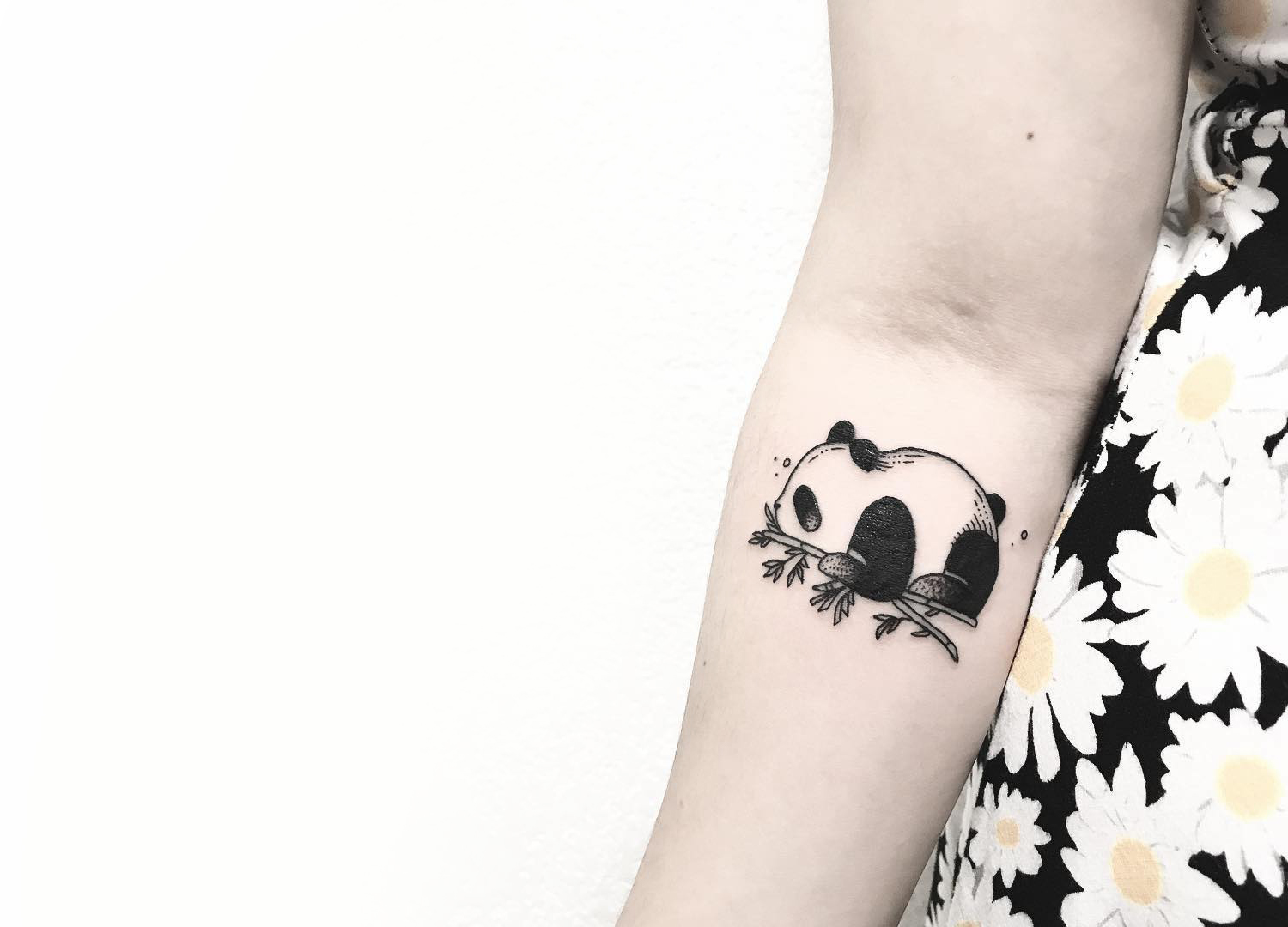 Tiny panda on arm