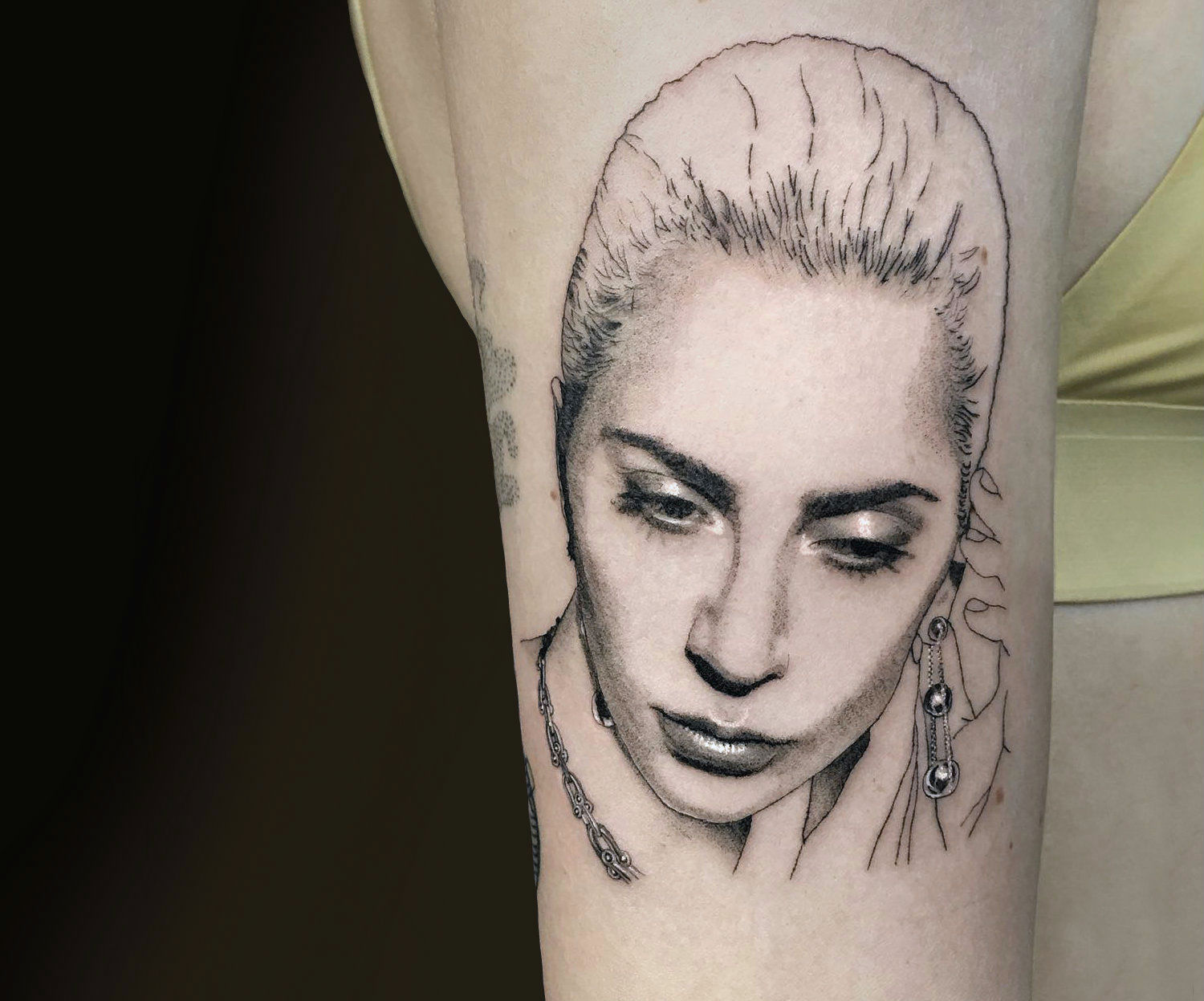 Glossy Lady Gaga portrait tattoo by Shannon Perry