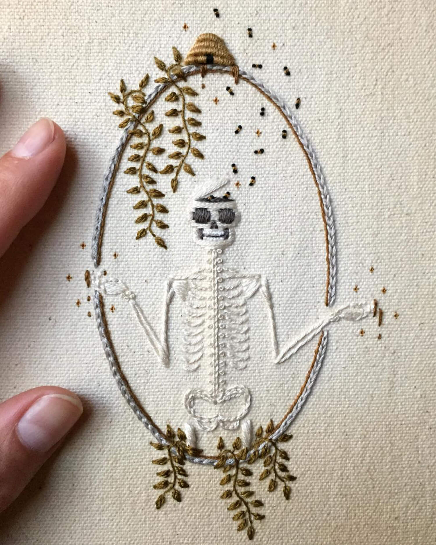 skeleton surrounded by leaves