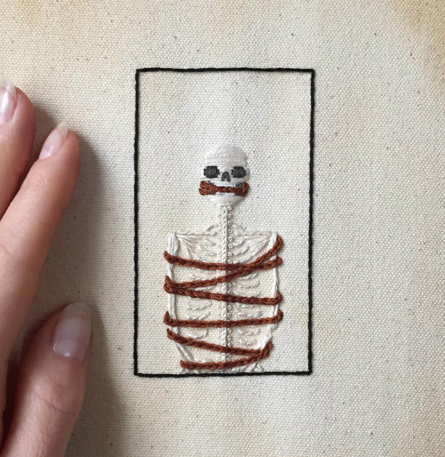 embroidery of skeleton tied up