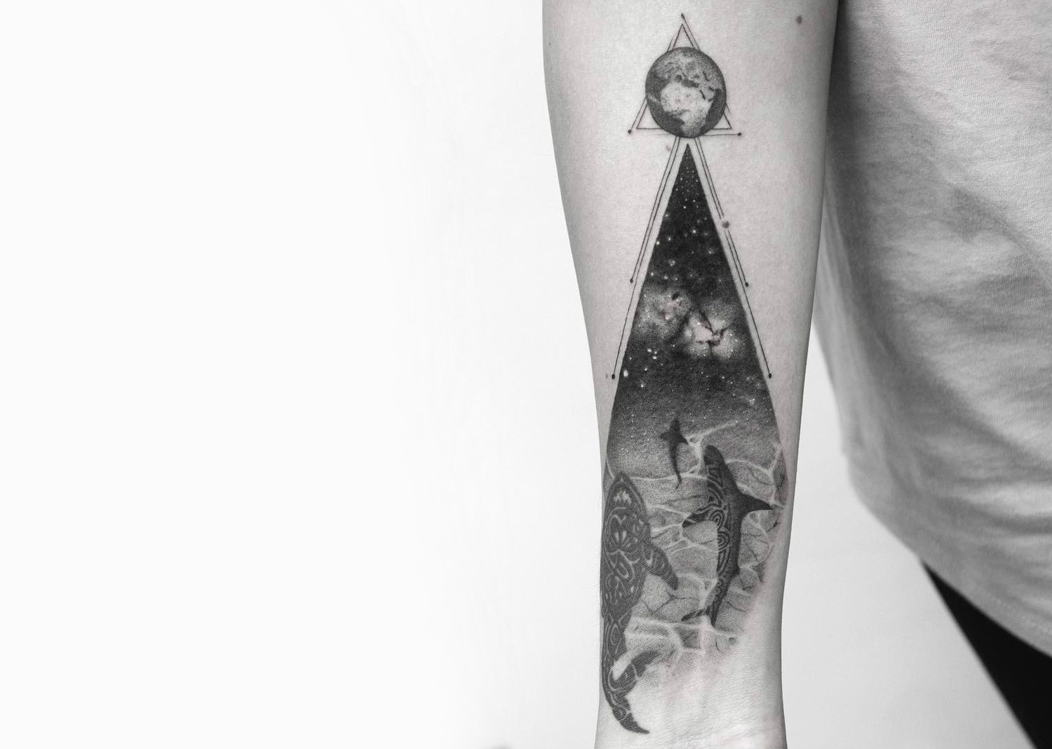 Sharks in the cosmos tattoo by Balazs Bercsenyi