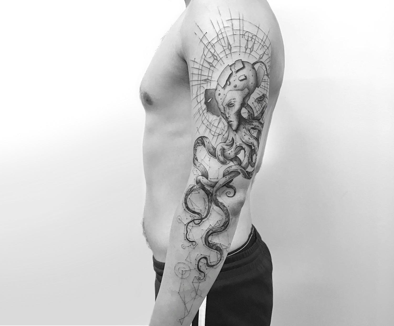 Alien octopus tattoo by Balazs Bercsenyi of NYC