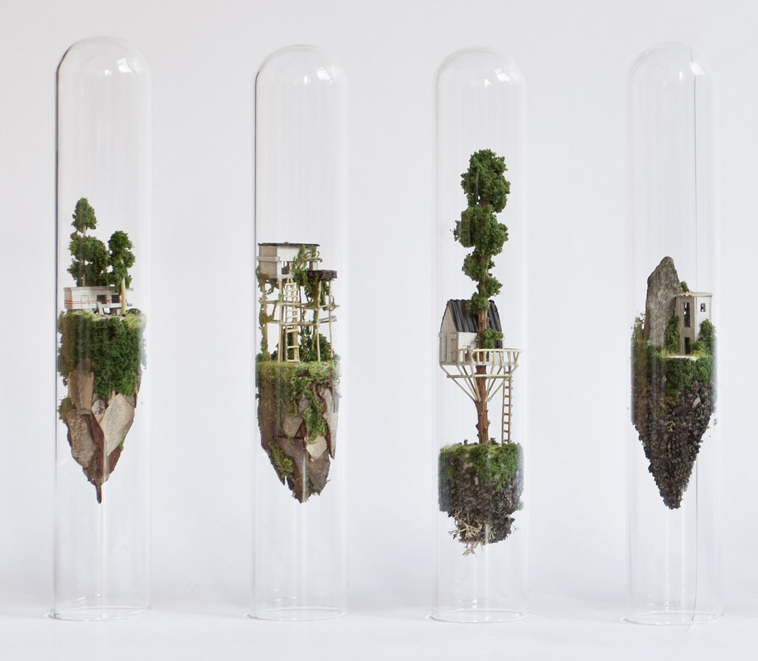 Miniature sculptures in glass tubes