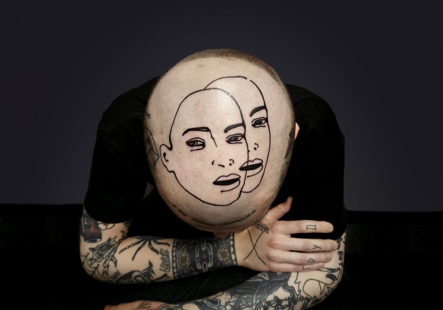 Double face tattoo on head by Andrey Volkov