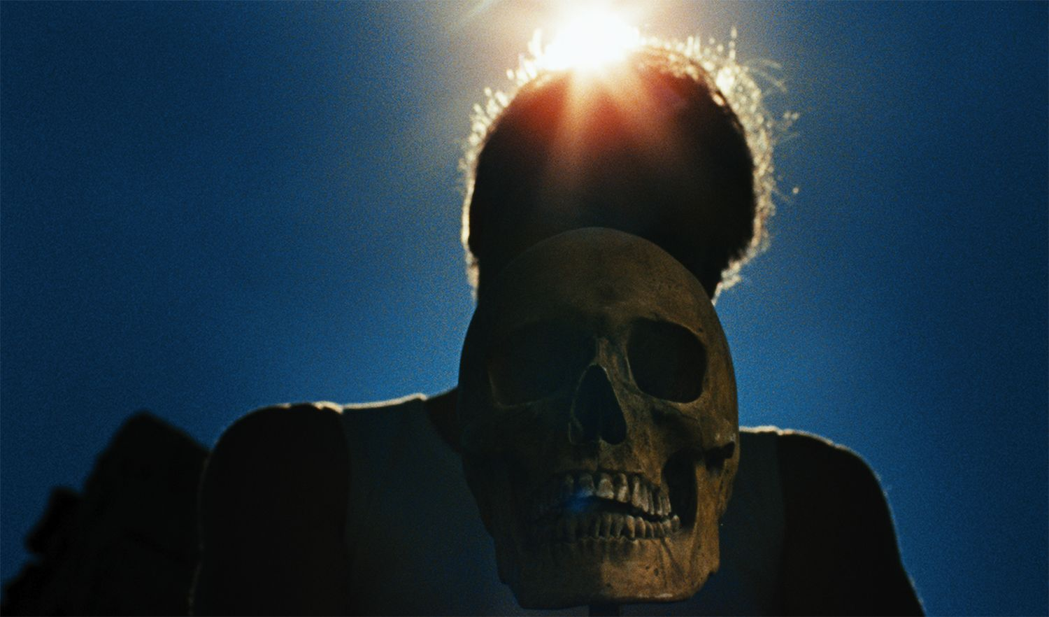 man and skull, Let the Corpses Tan