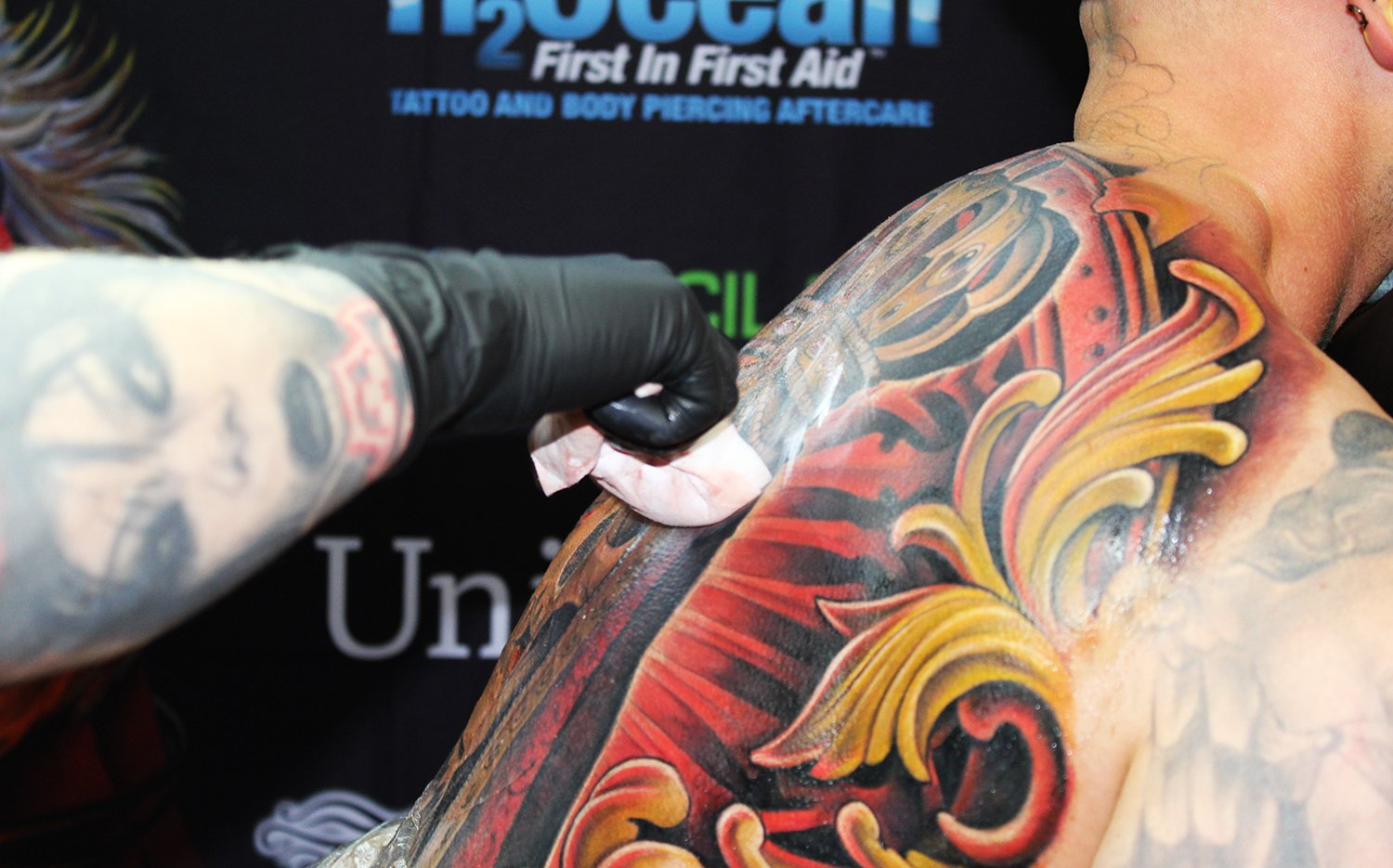 Julian siebert tattooing another epic back piece, color