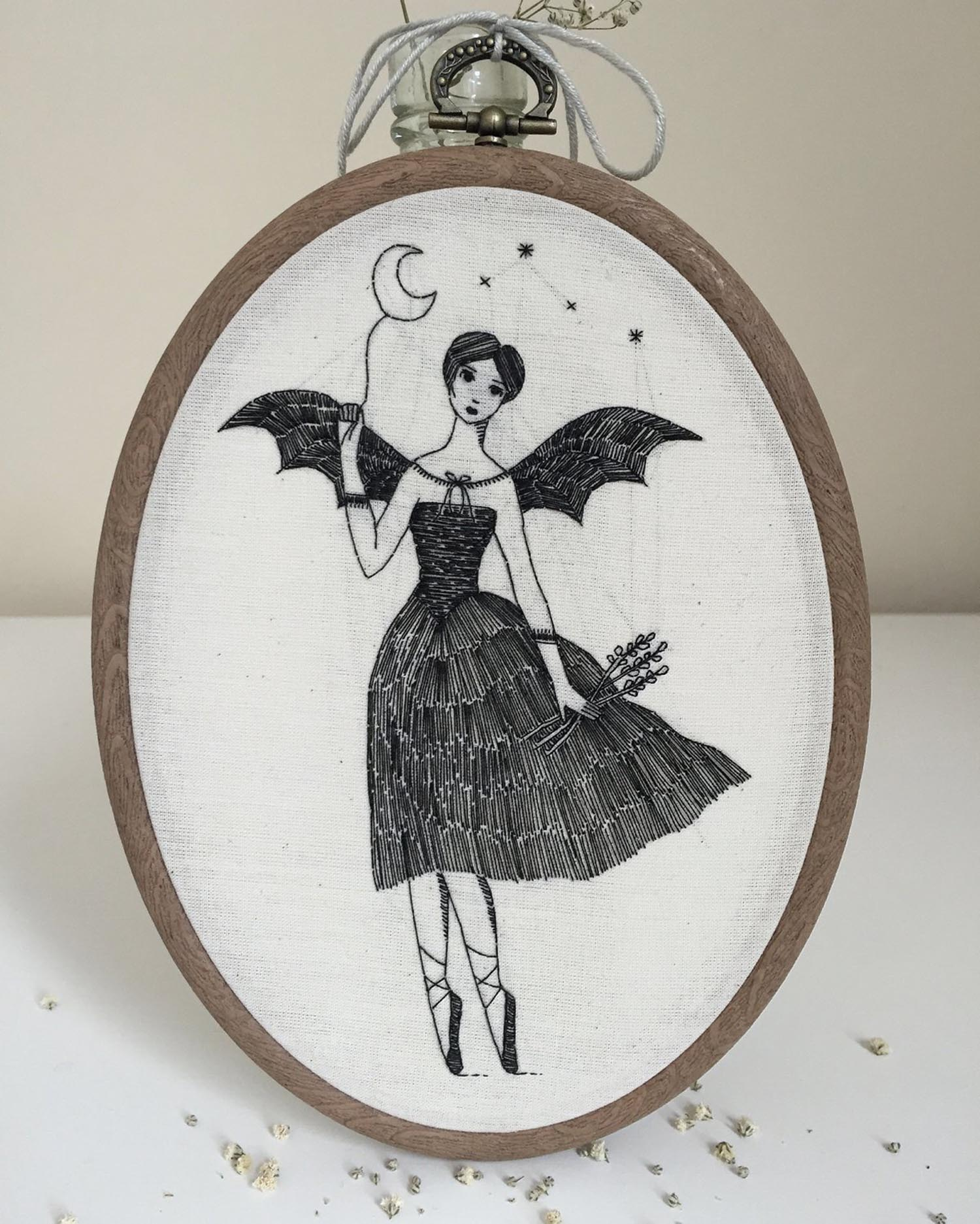 Embroidery of a woman bat