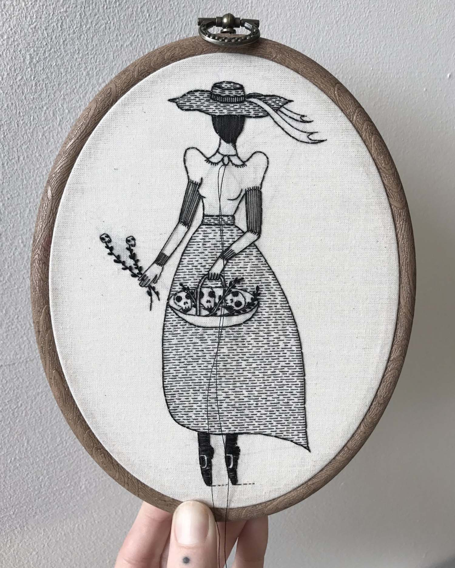 Embroidery of a faceless woman