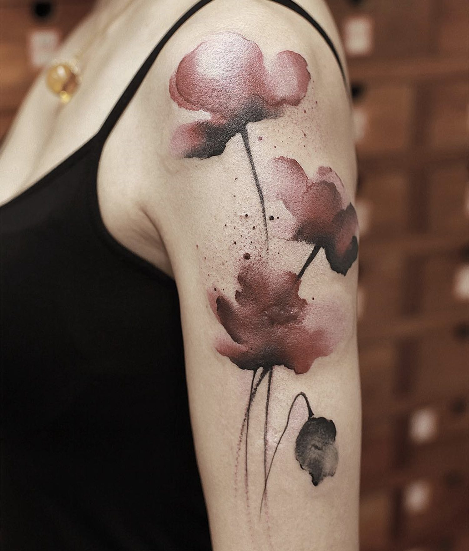 red flowers, painting style tattoo, sleeve