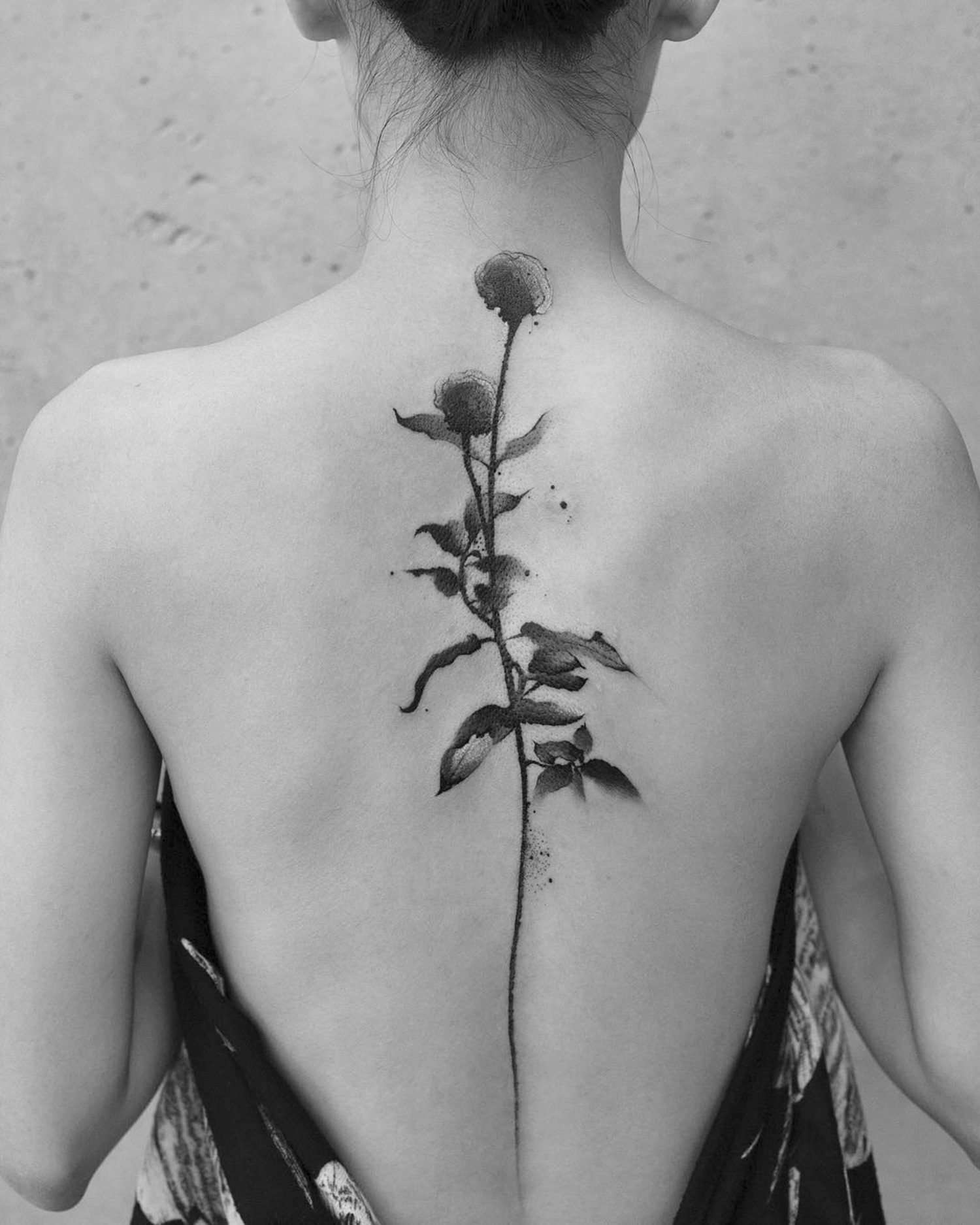 flowers on back, blackwork tattoo