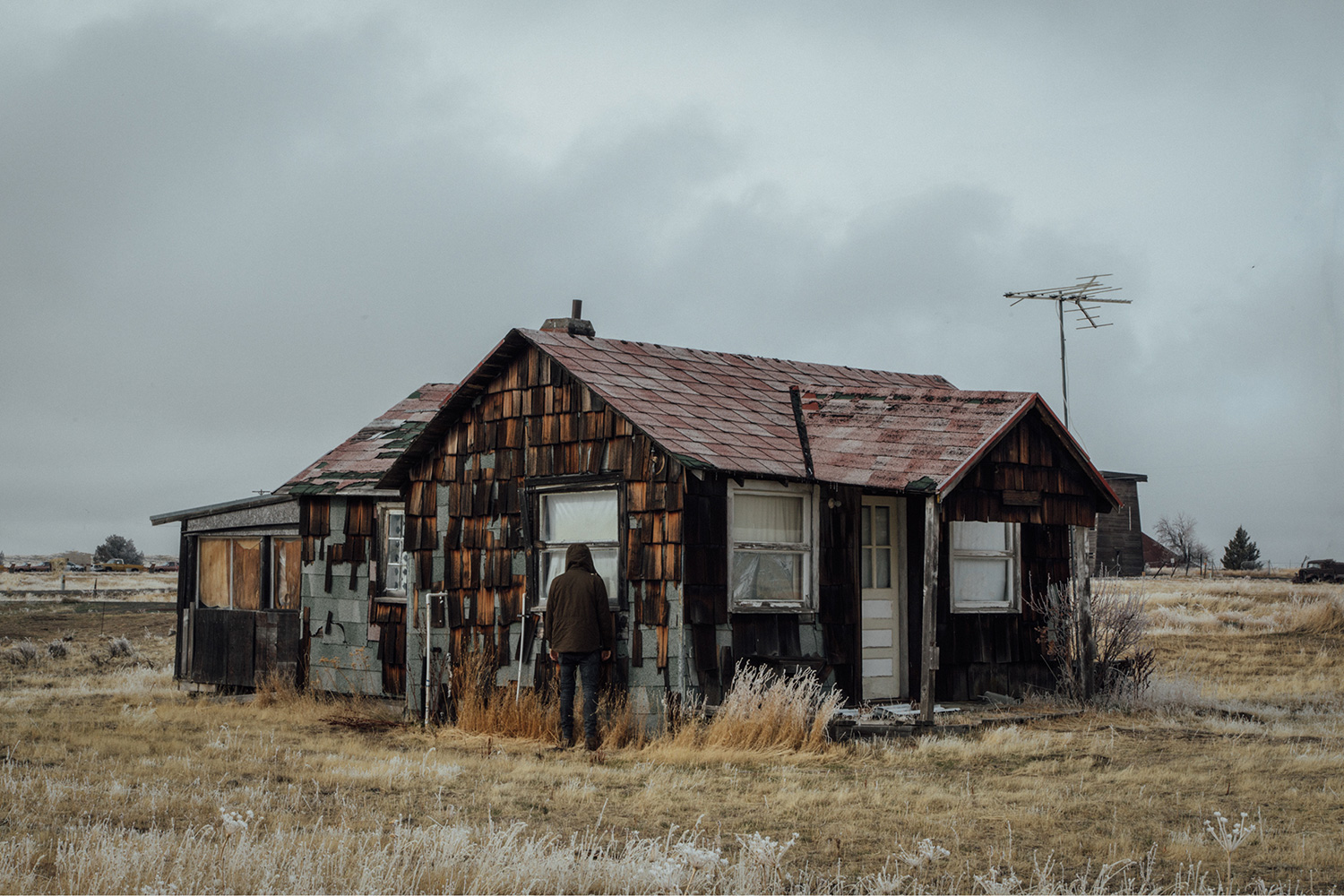 Brendon Burton, Western Gothic - man looking into abandoned house