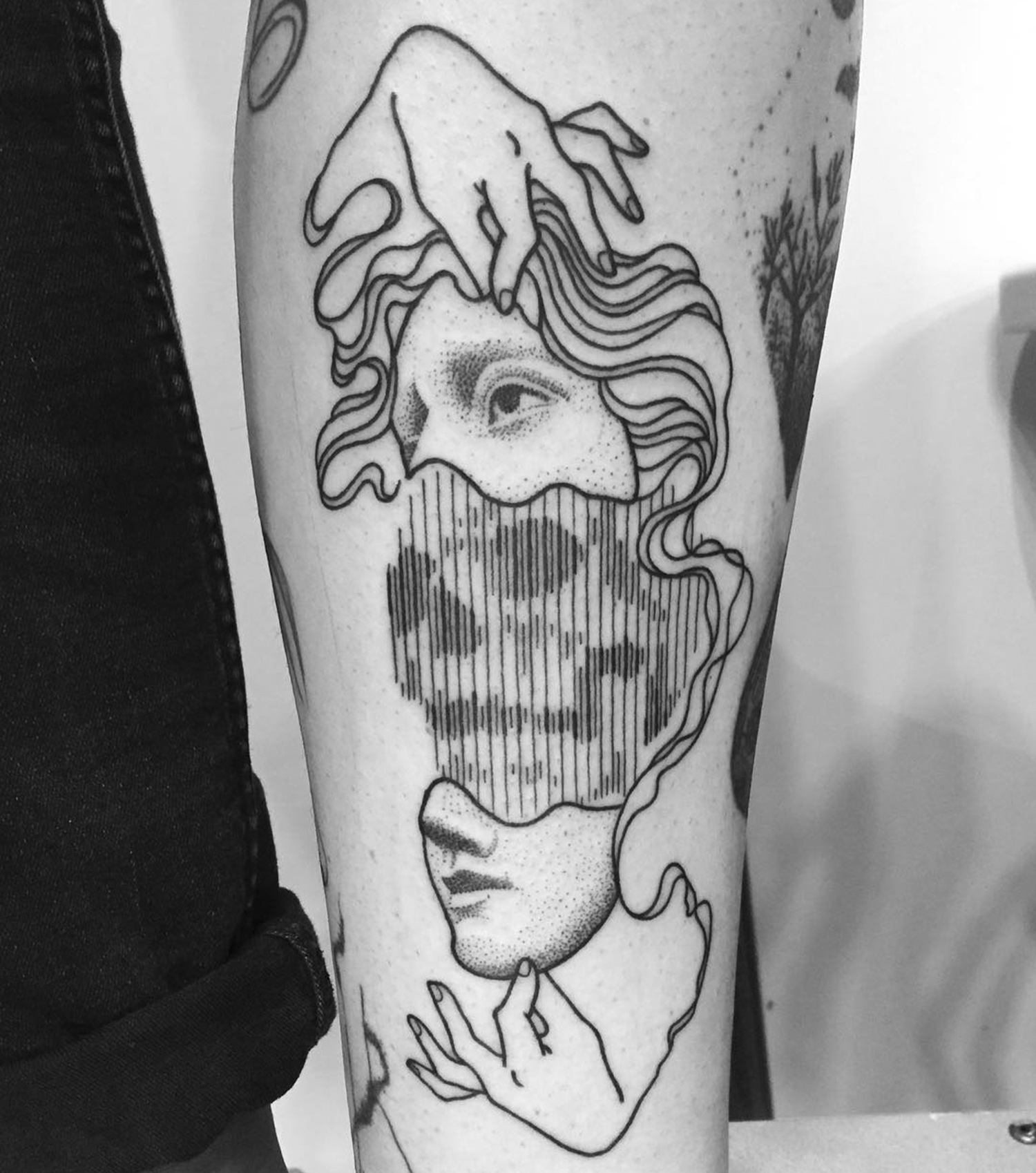 taking off the mask. blackwork tattoo by Francesco Rossetti