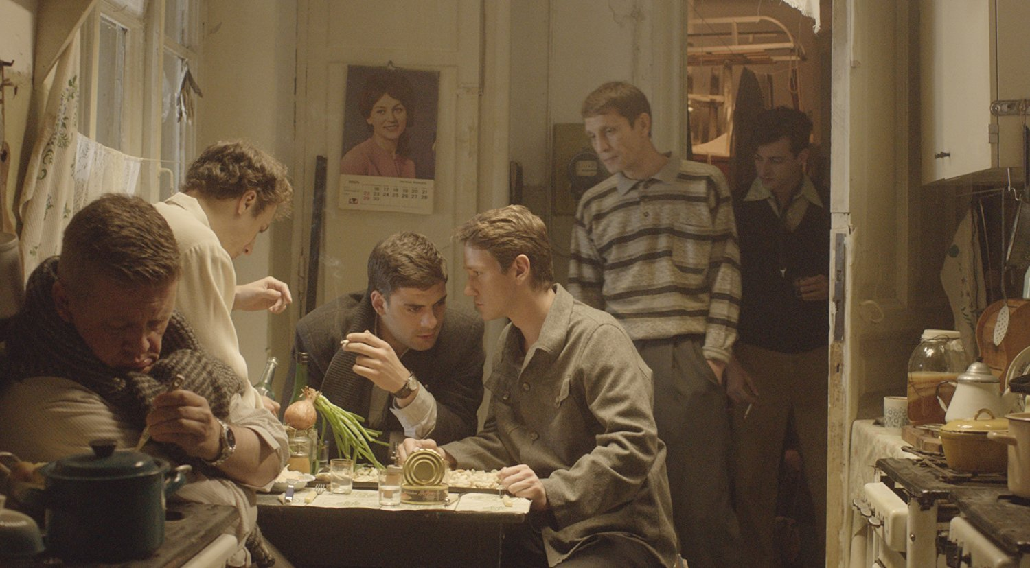 guys talking, scene from Dovlatov
