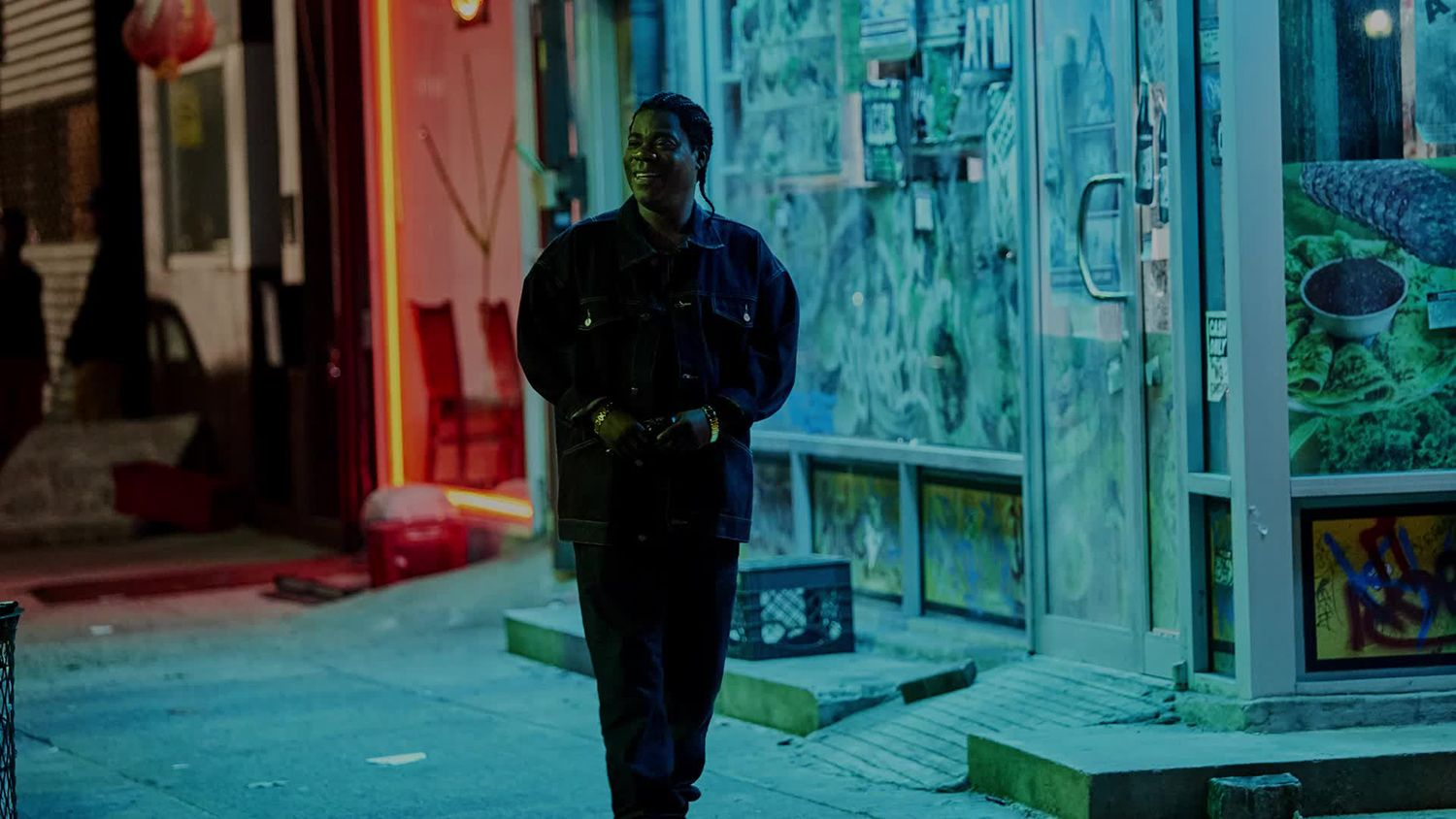 man walking at nighttime on street, The First Purge