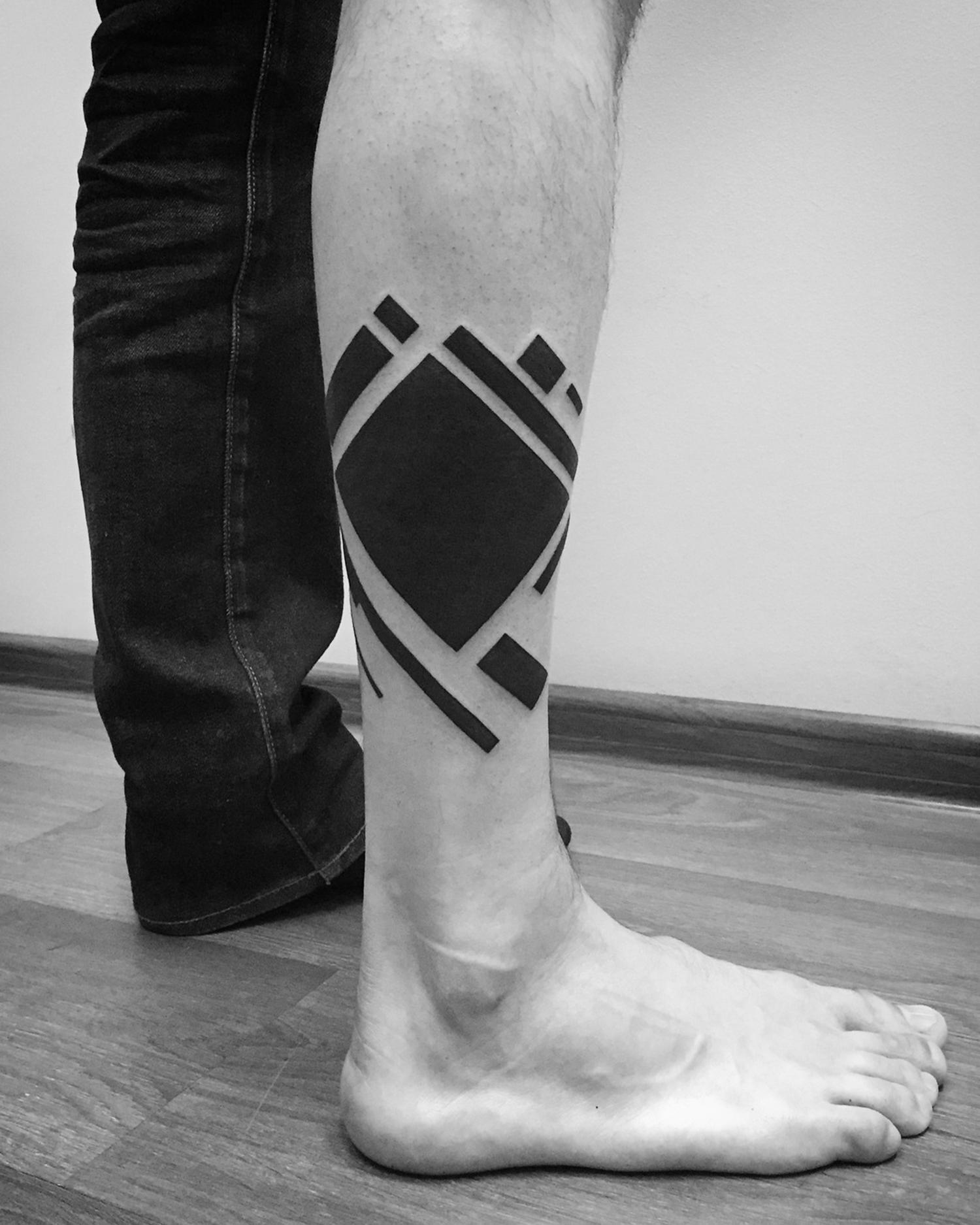 geometric blackwork tattoo on leg