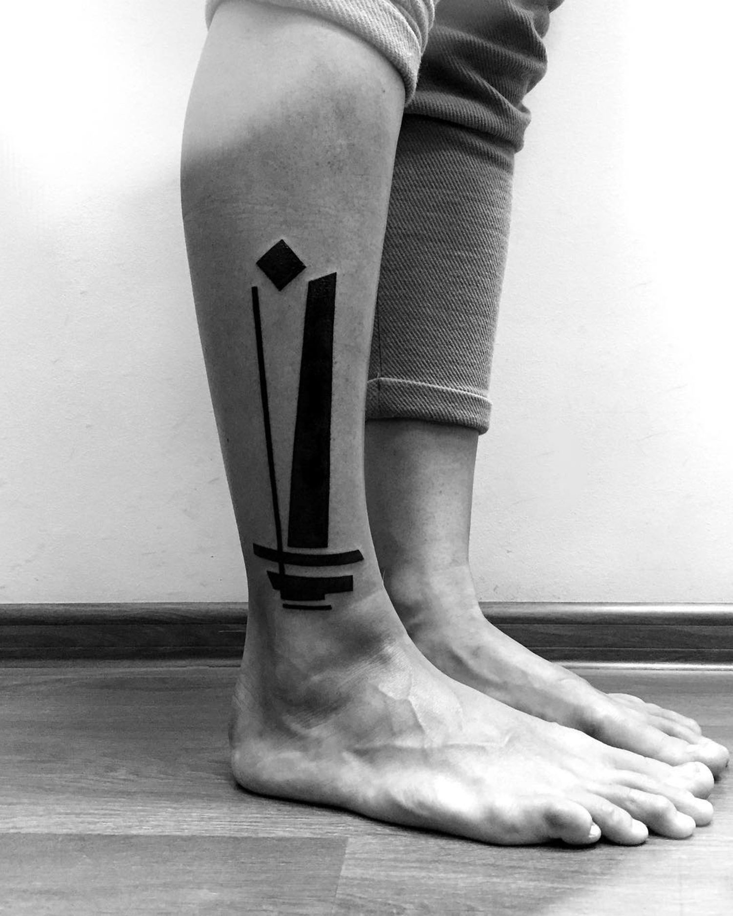 abstract tattoo in black ink on leg