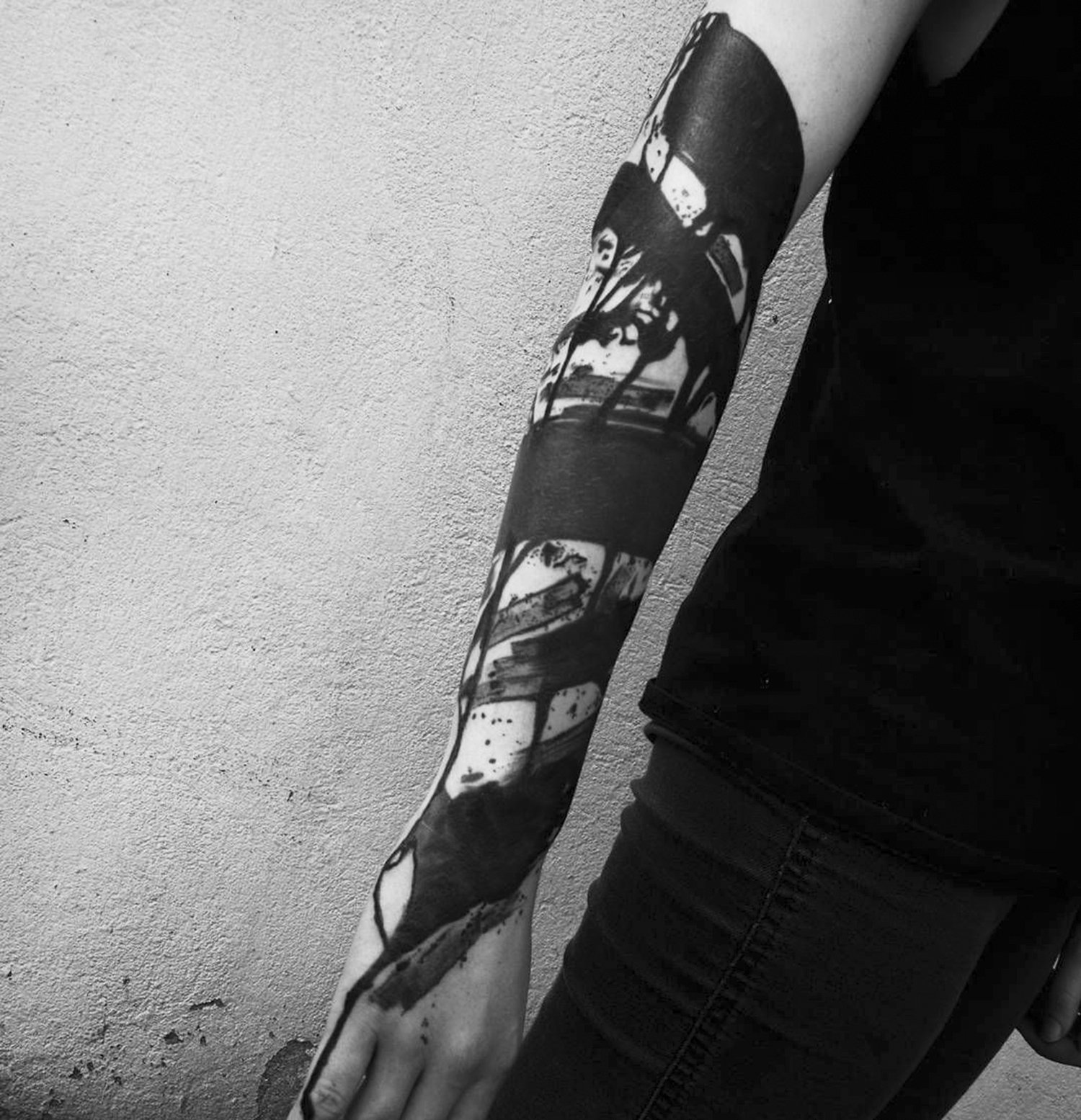 brushstroke blackwork tattoo on arm, painting style
