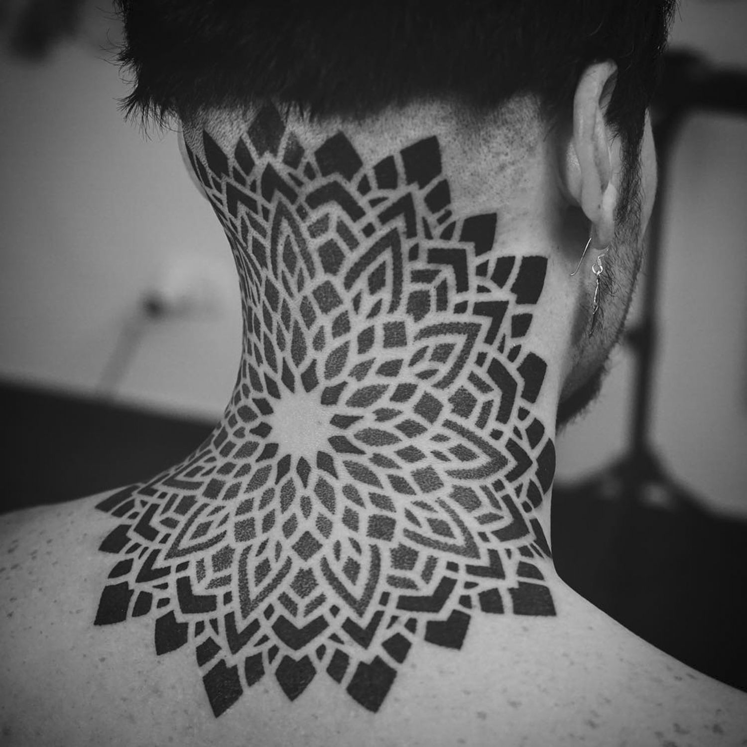 blackwork neck tattoo