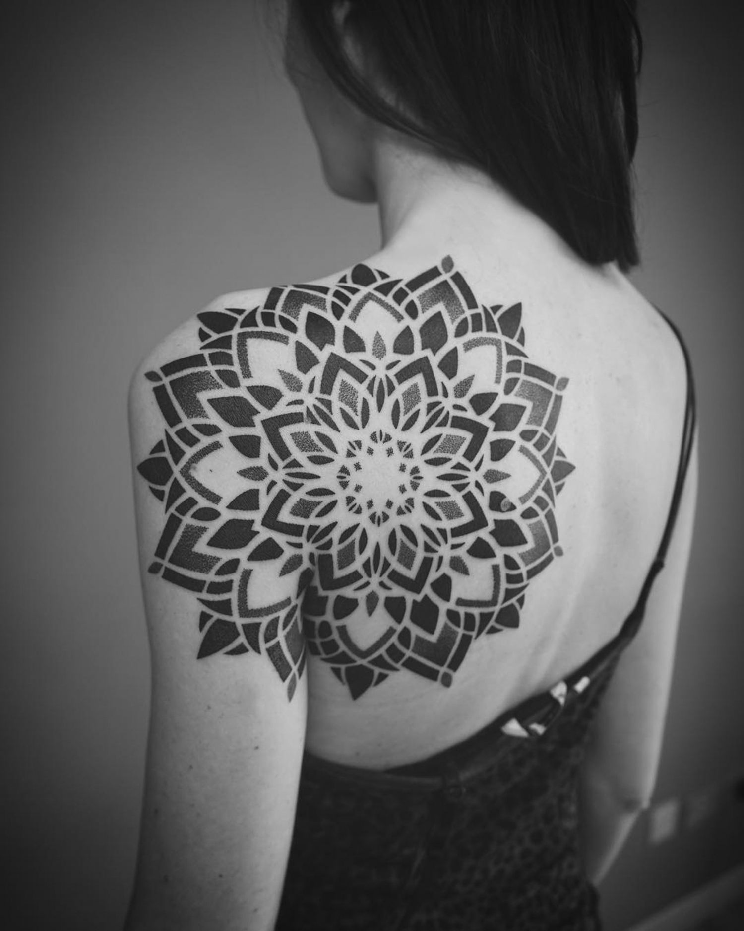 geometric tattoo on shoulder