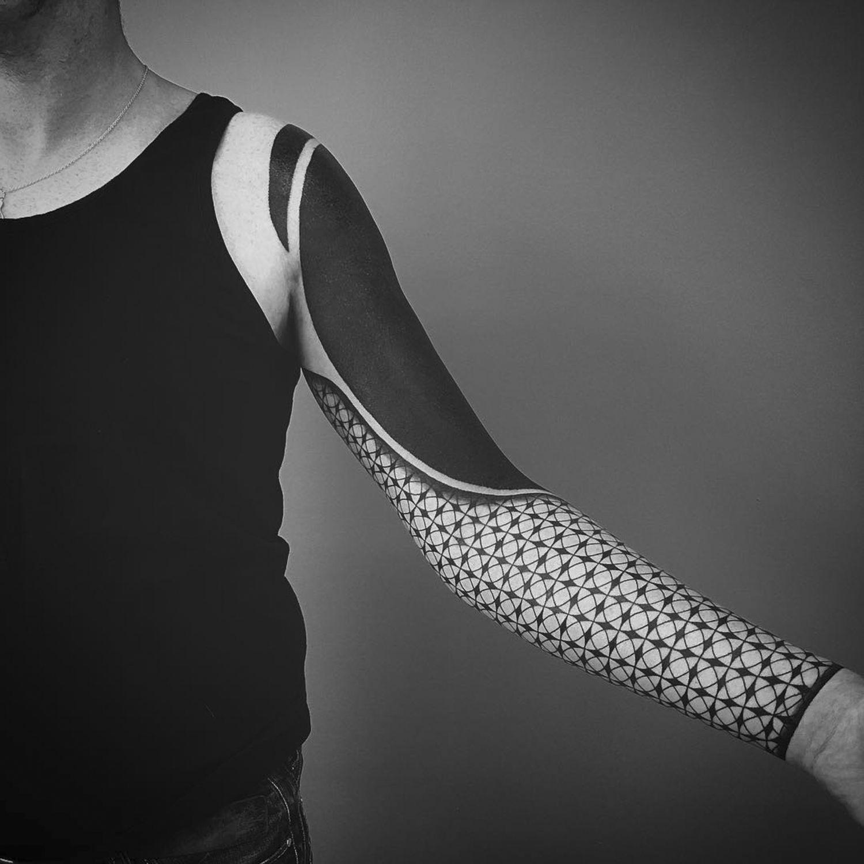 blackwork tattoo on arm