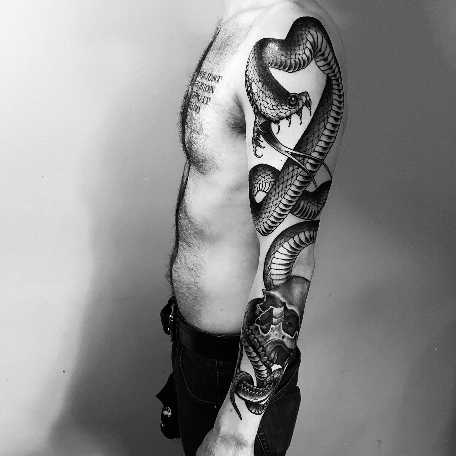 Joao Bosco - snake arm tattoo