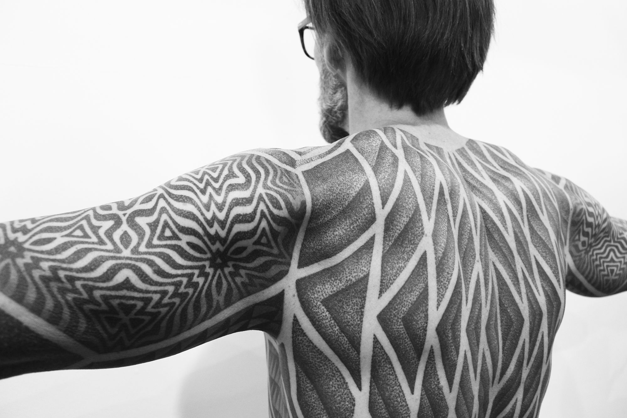 eric tattooed with bodysuit, dotwork by lewisink, photo by scene360