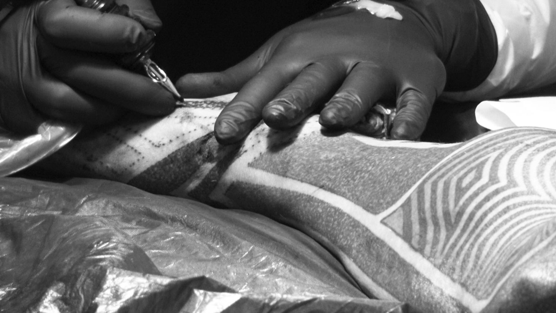 foot being tattooed. dotwork by lewisink