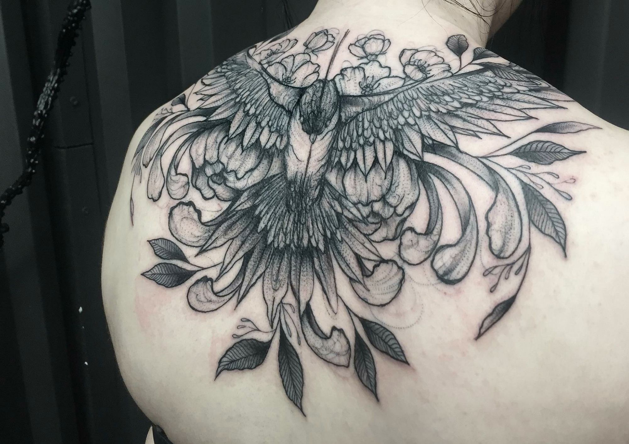 bird tattoo on back, illustrative style