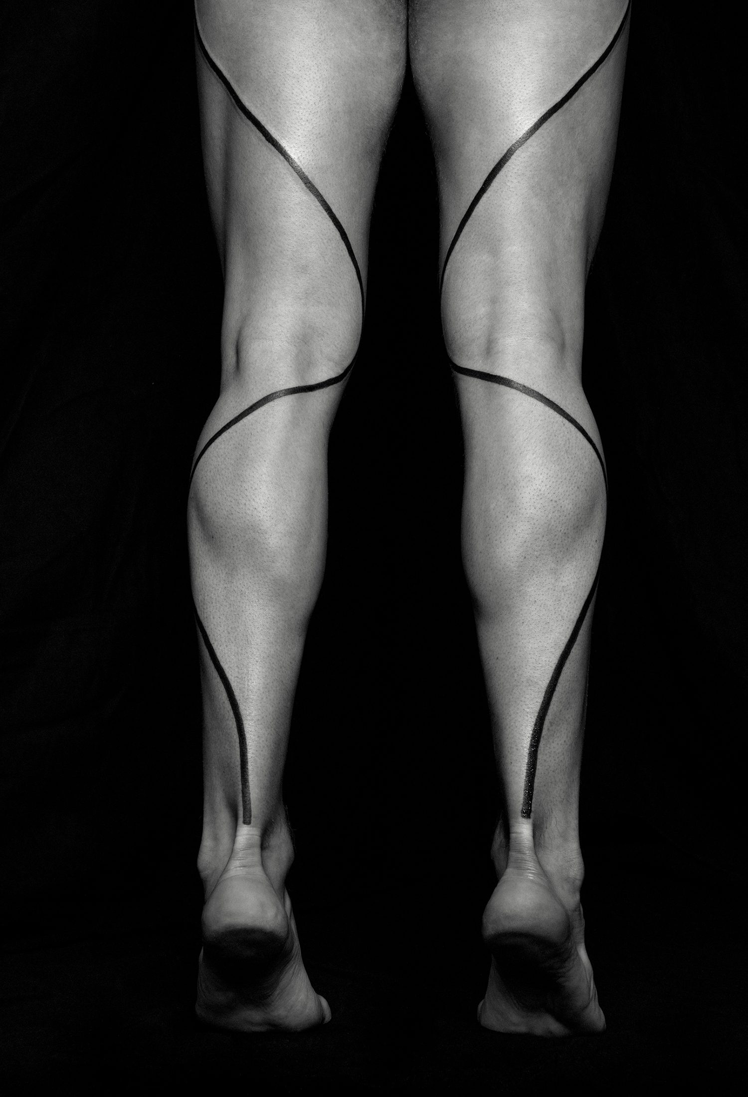 line tattoo on legs by chaim machlev. photo © erik weiss