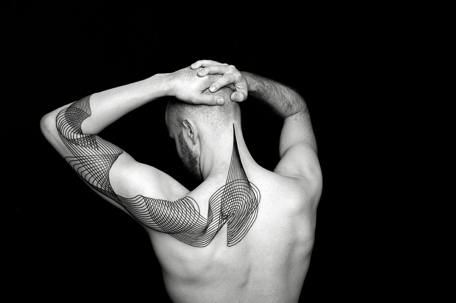 linework on back by chaim machlev. photo © erik weiss