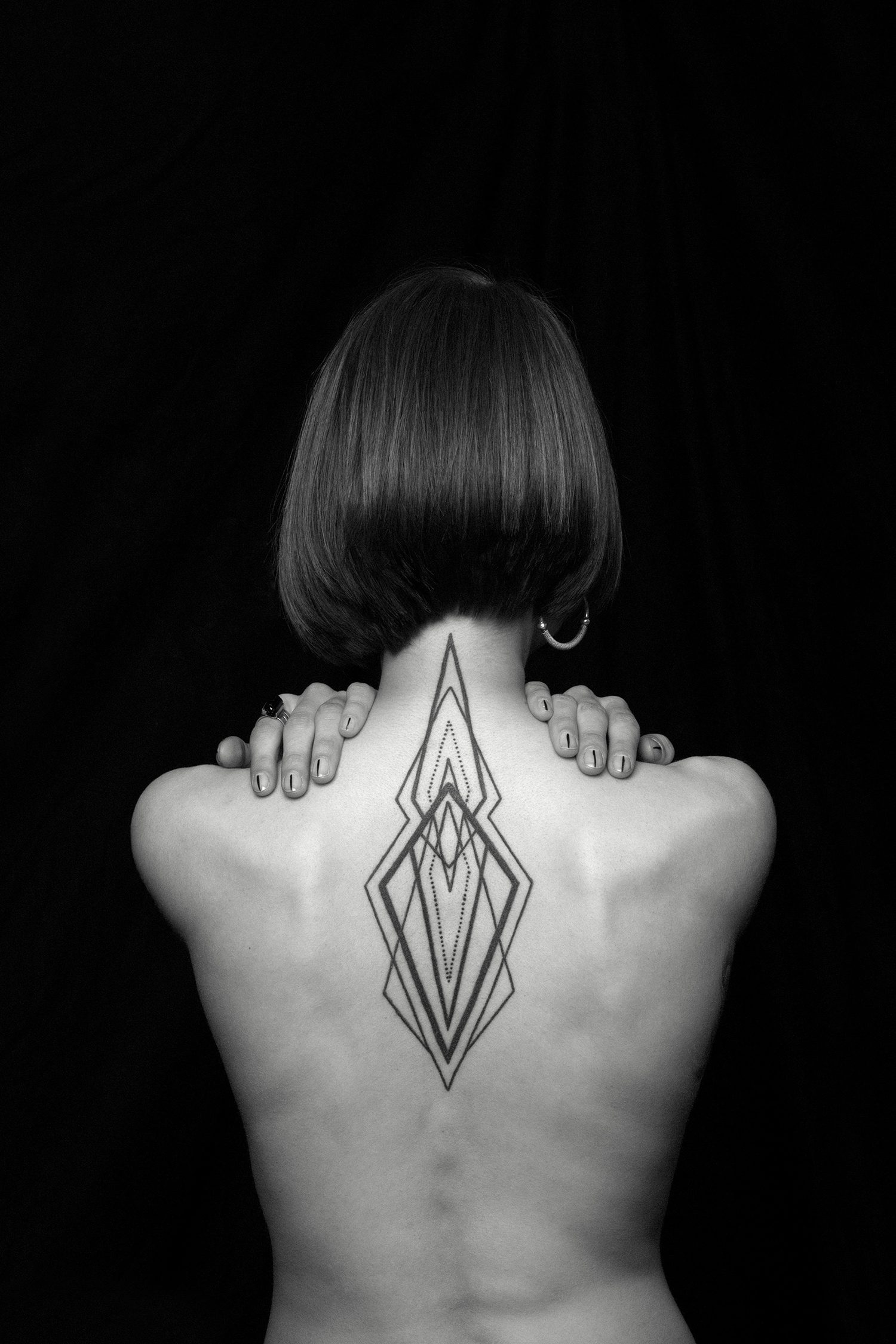 geometric tattoo on back by chaim machlev. photo © erik weiss