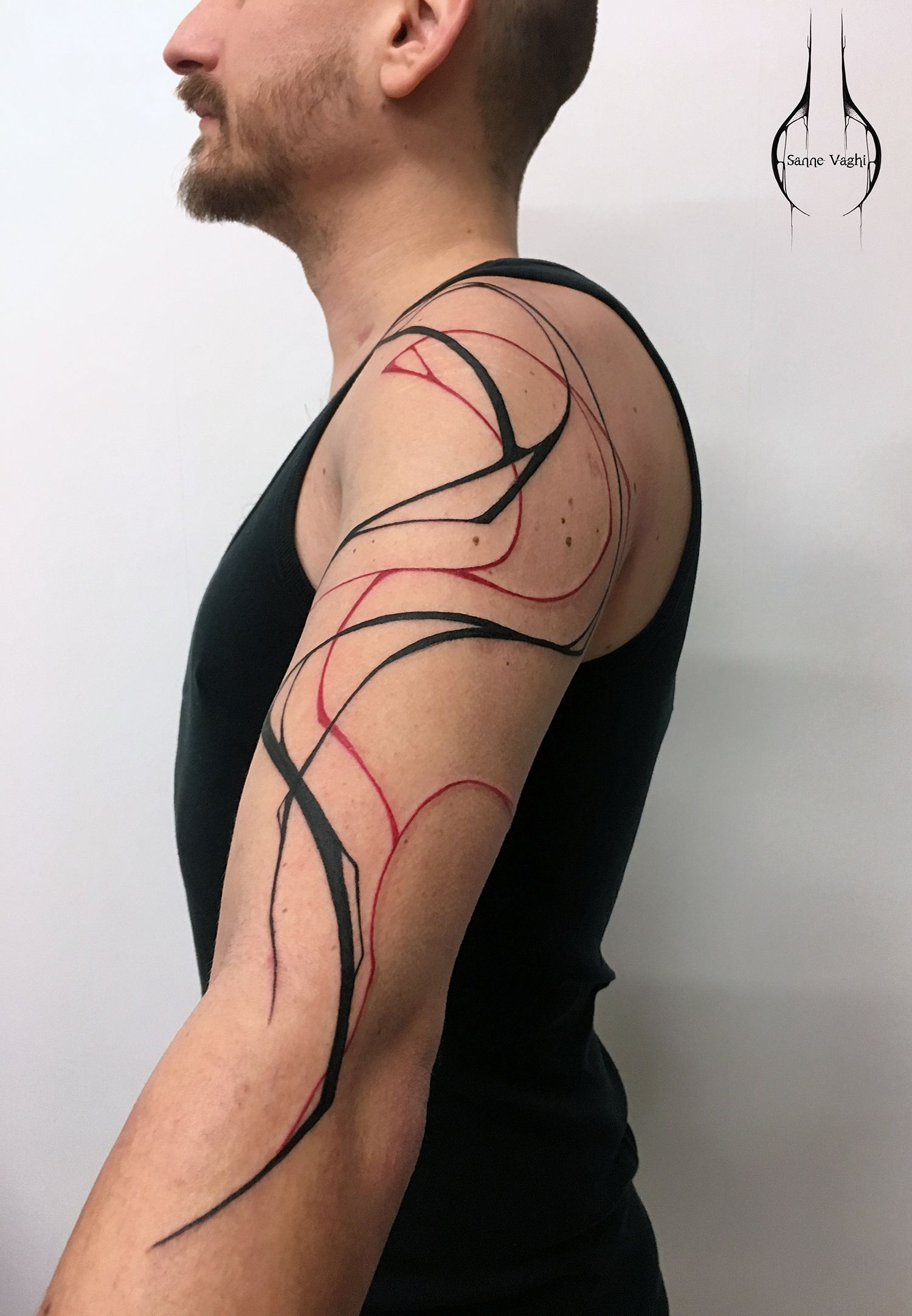 red and black tattoo on shoulder abstract shoulder tattoo by sanne vaghi