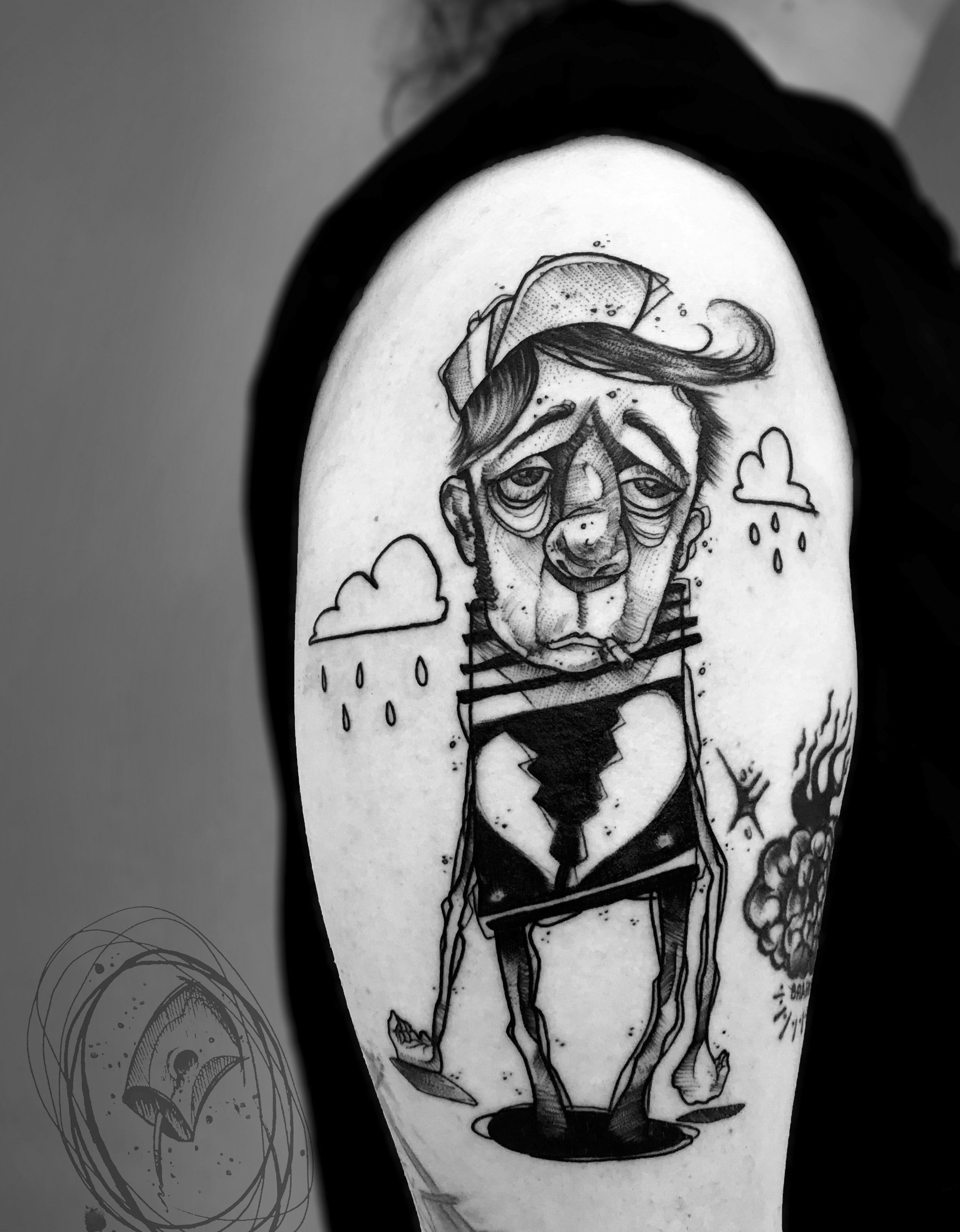 sad man, broken heart tattoo