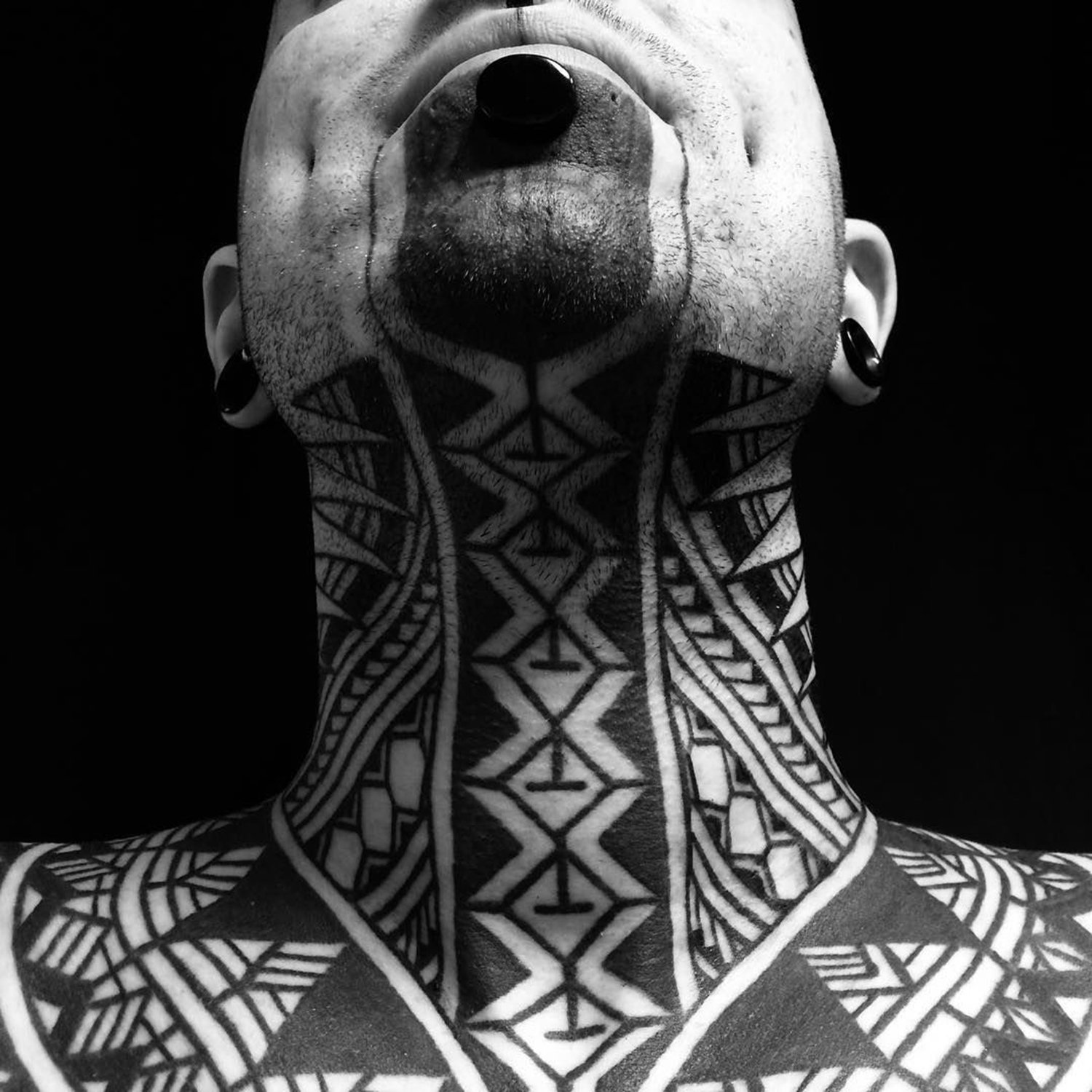 geometric blackwork on neck, neotribal