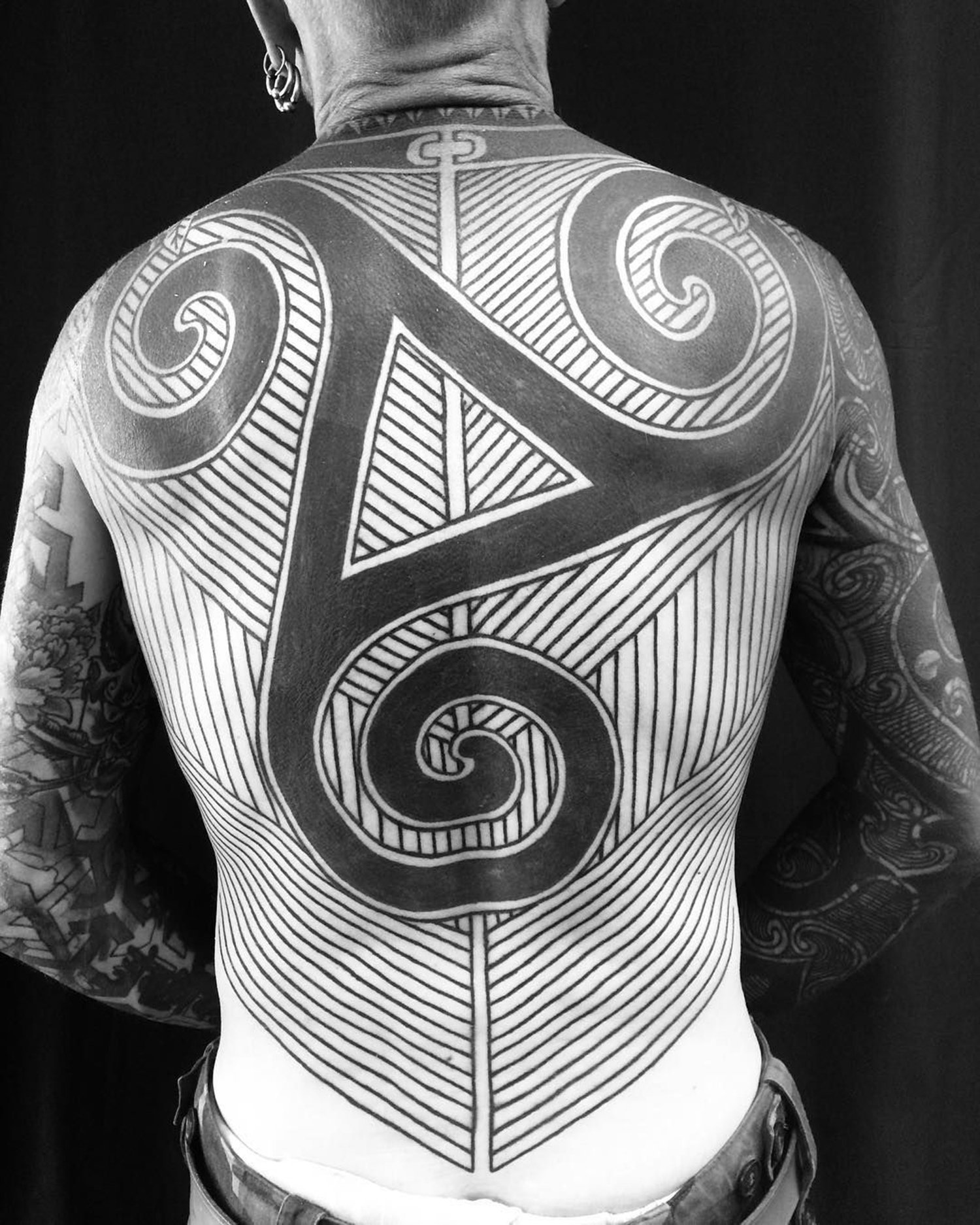 abstract geometric back tattoo