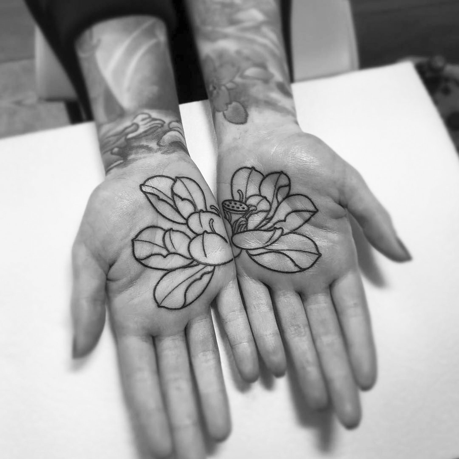 lotus hand tattoo