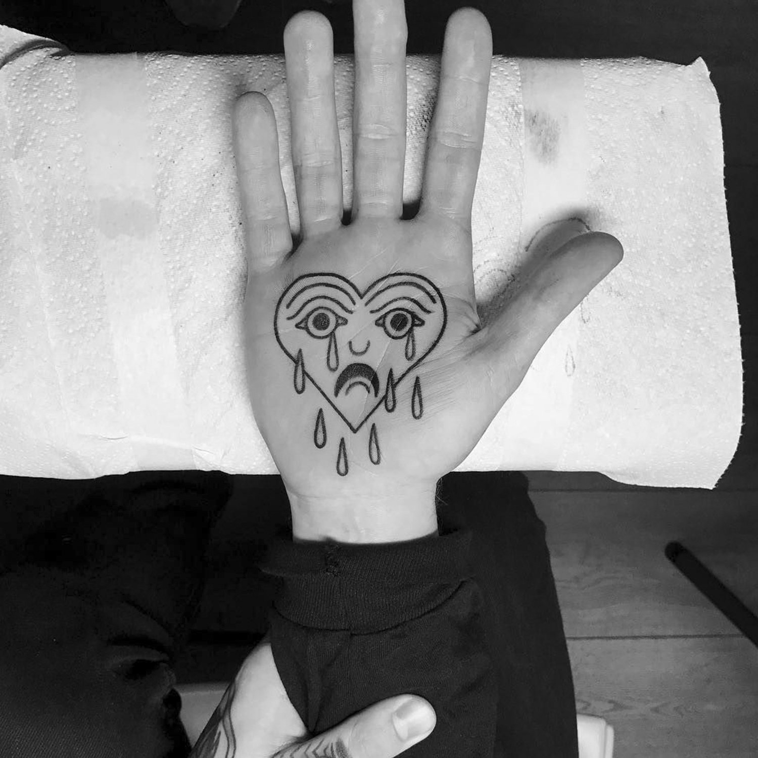 cry baby tattoo heart on hand