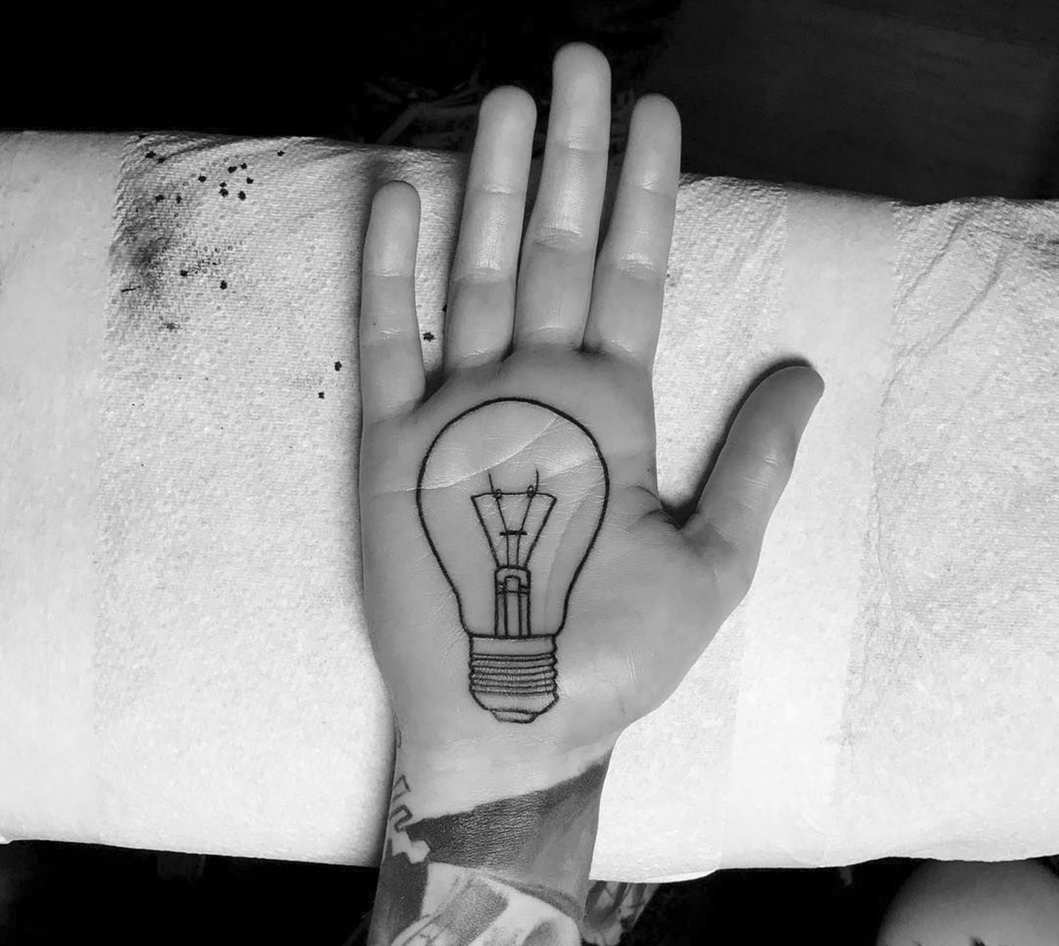 light bulb tattoo on palm